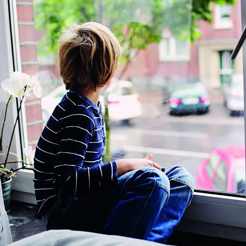 A child looking out of a window