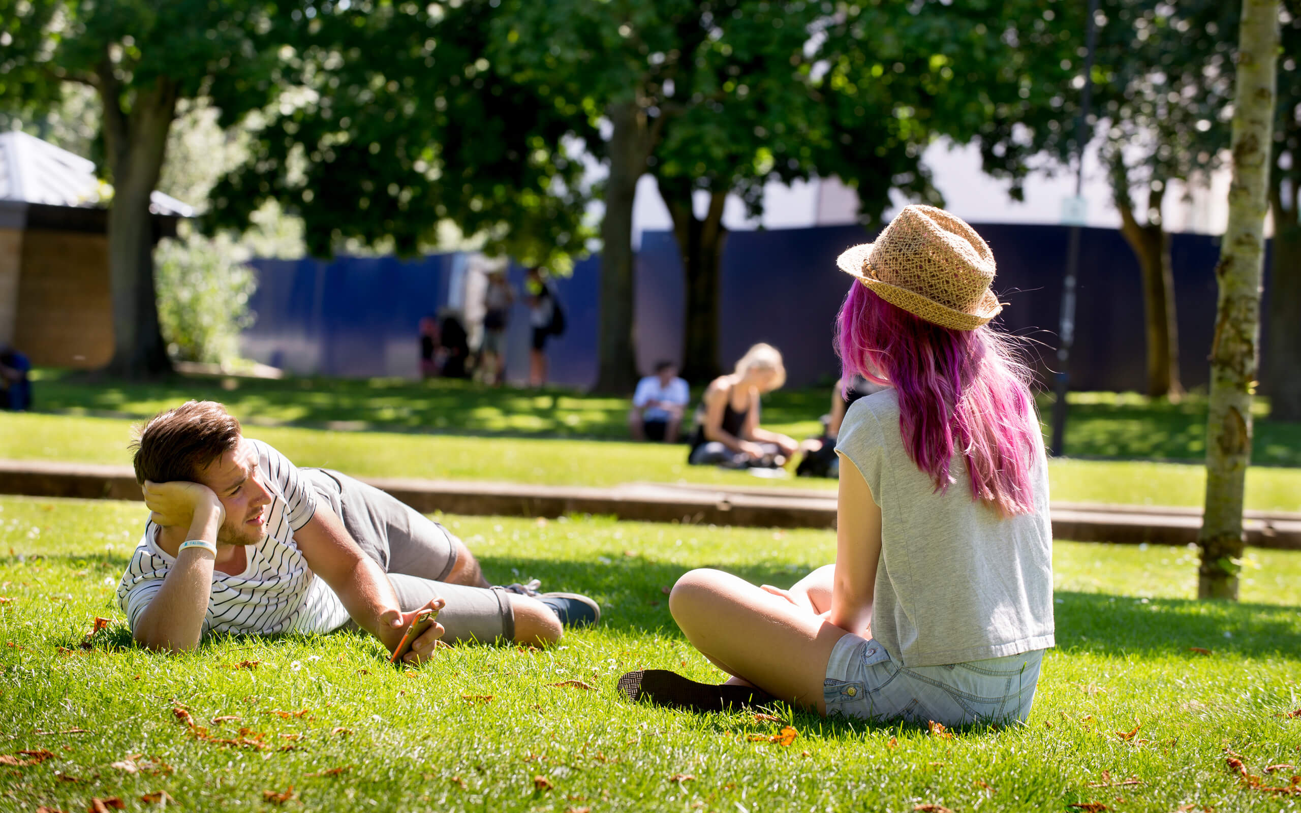 Two students talking in an outdoor space