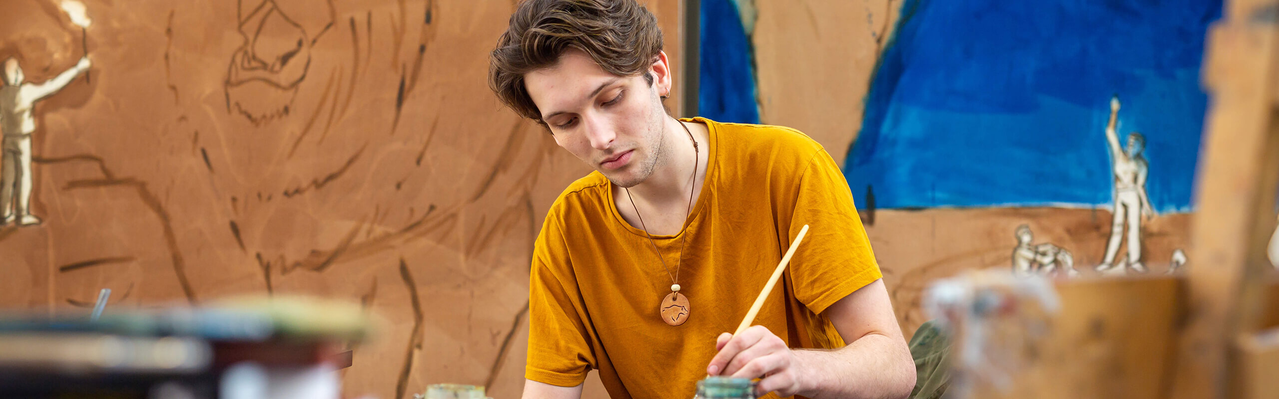 A Fine Art student working in his studio space