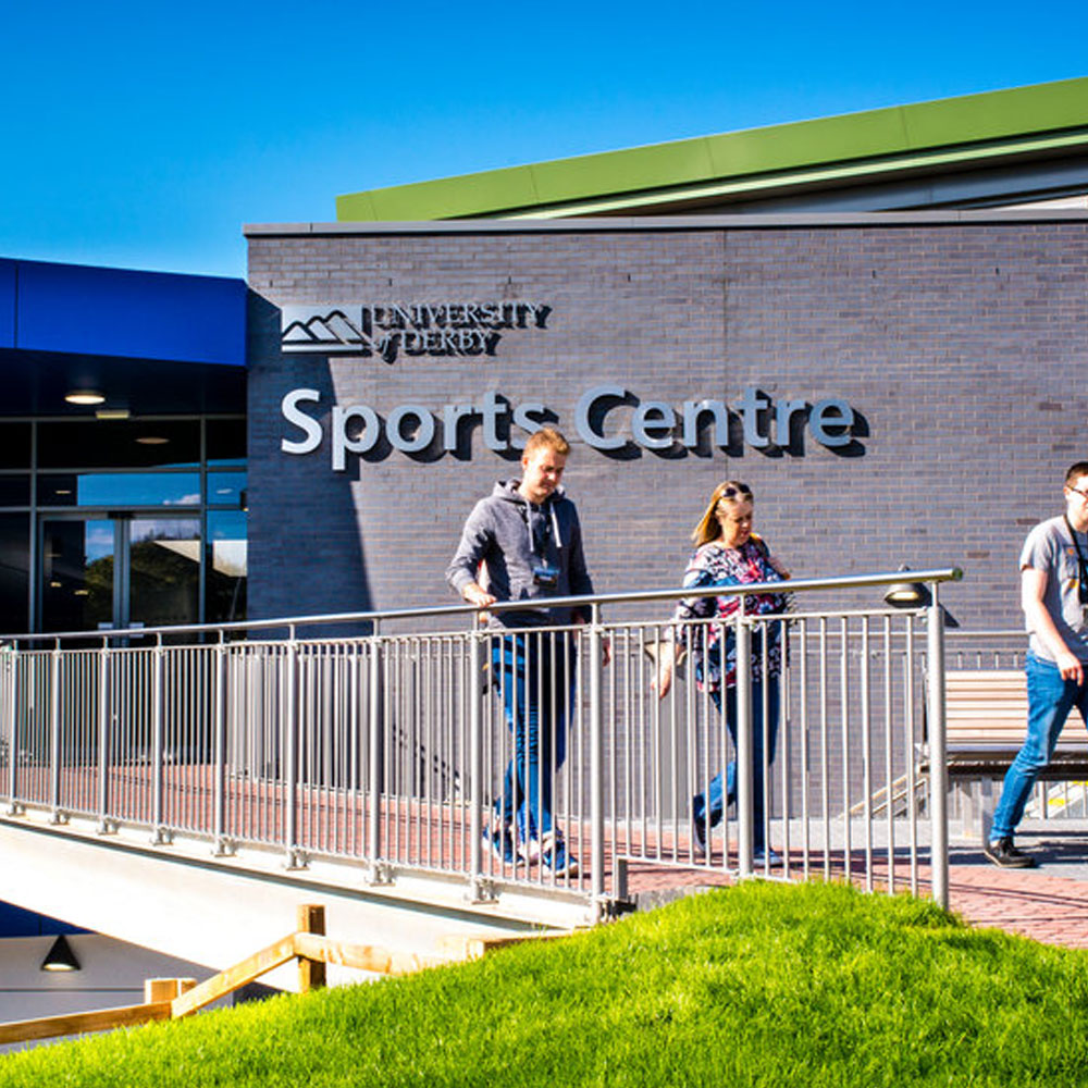 Students walking outside the Sports Centre