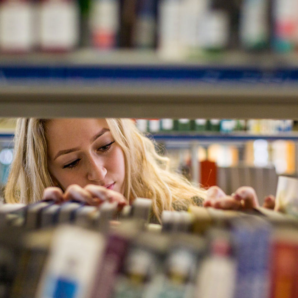 Student browses books in a library