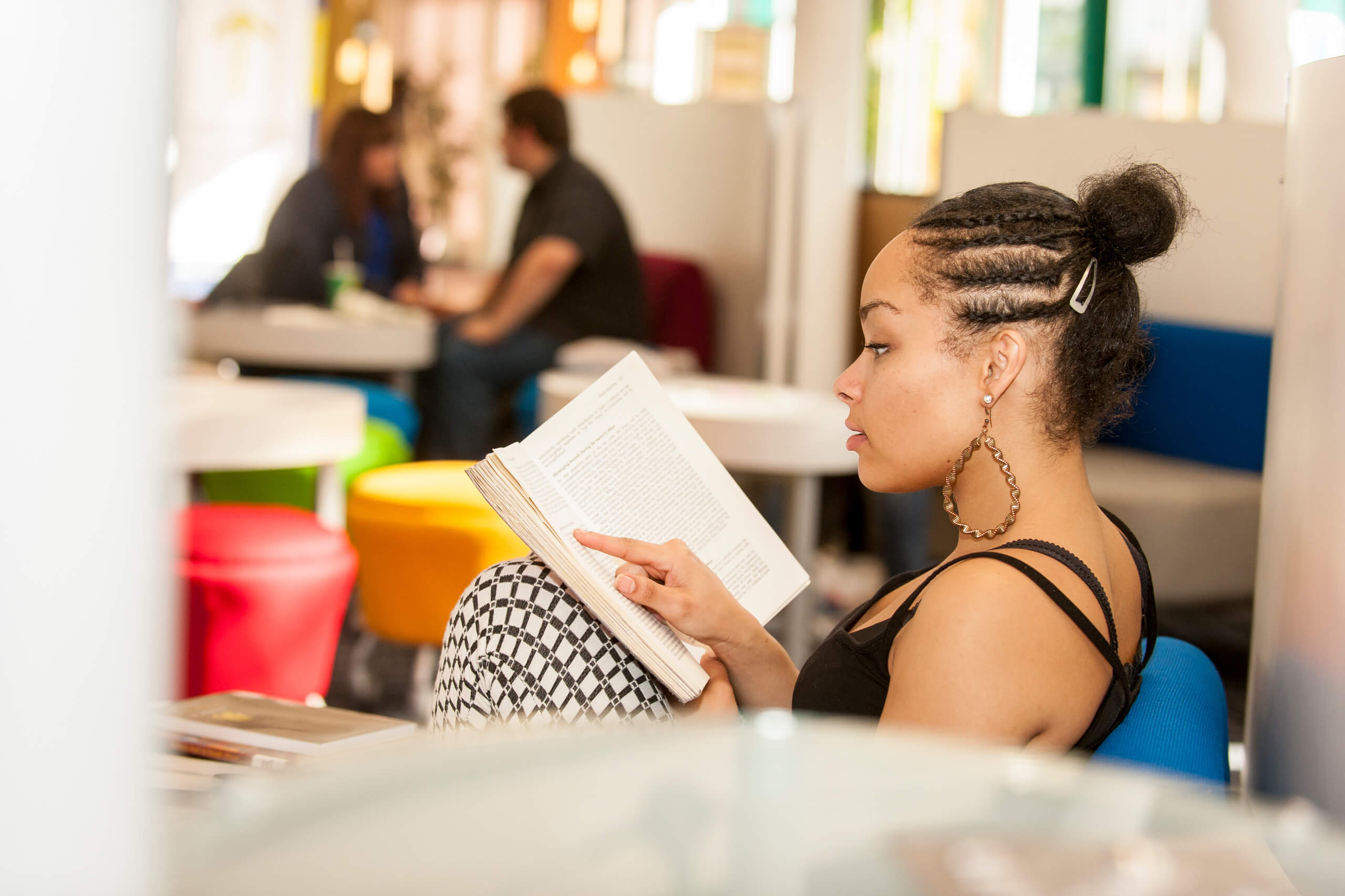 a student reading in the Atrium