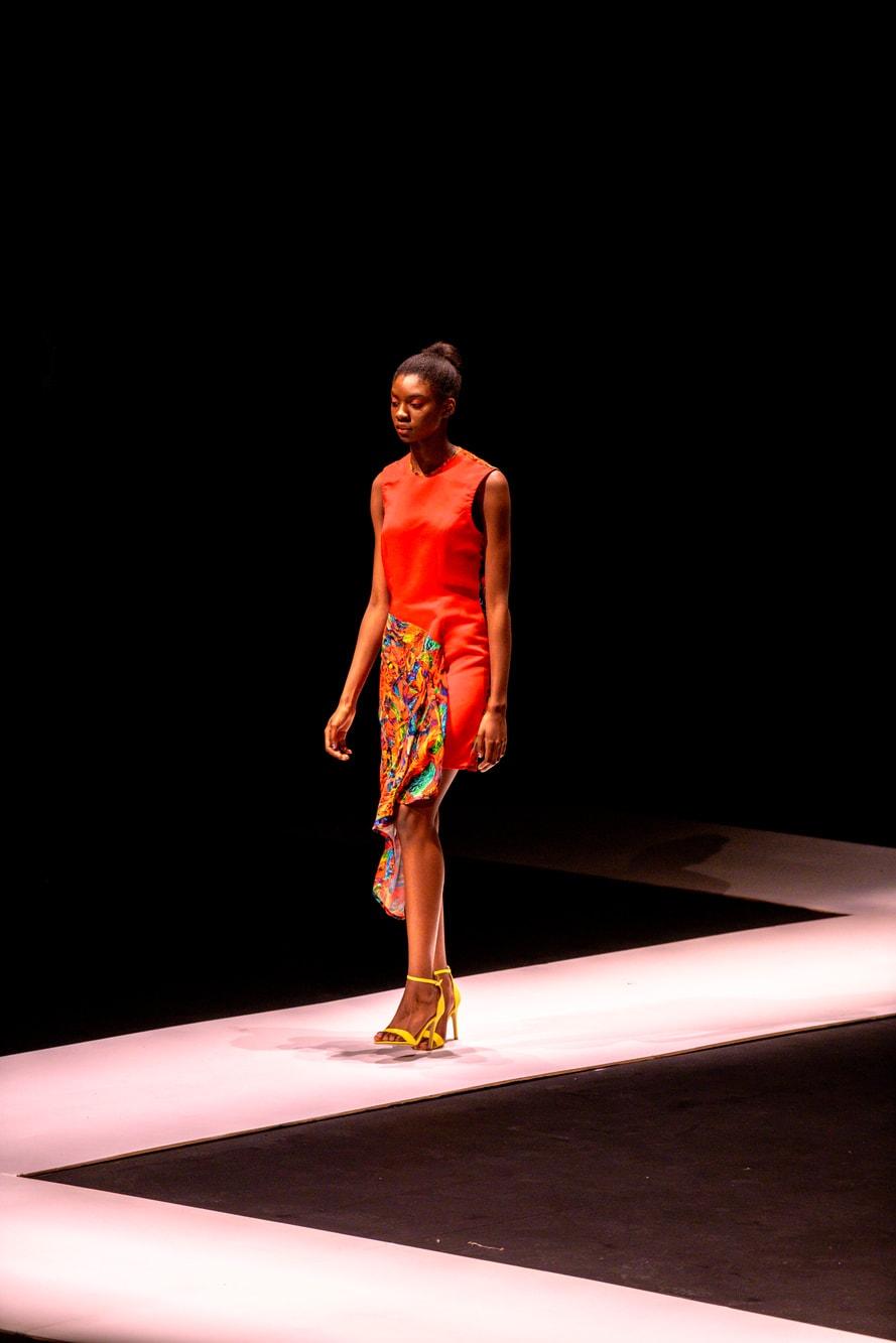 Bright orange dress on a catwalk model