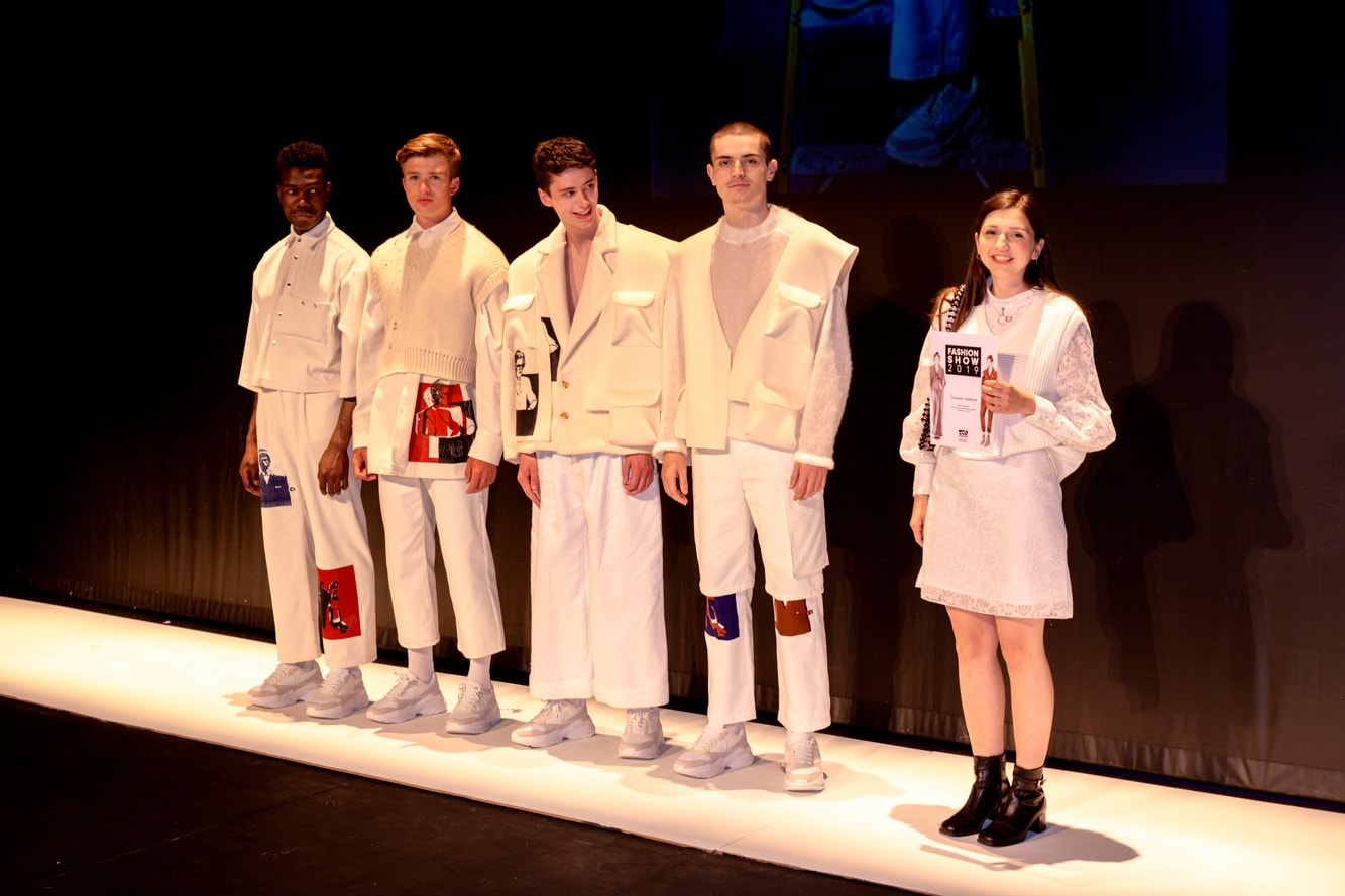 A winning menswear fashion collection on a catwalk with their designer