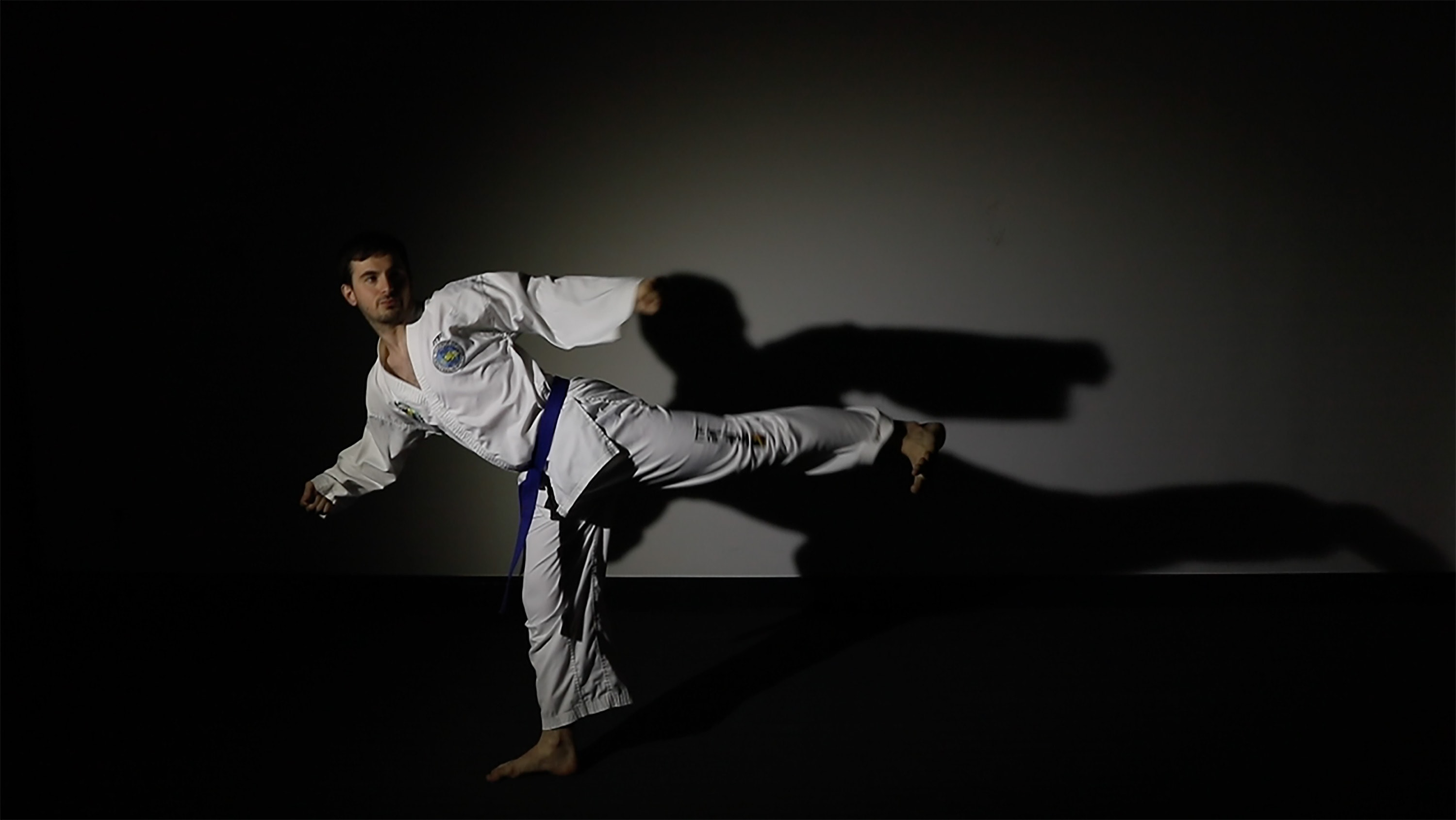 Martial arts motion of a man in a kicking position