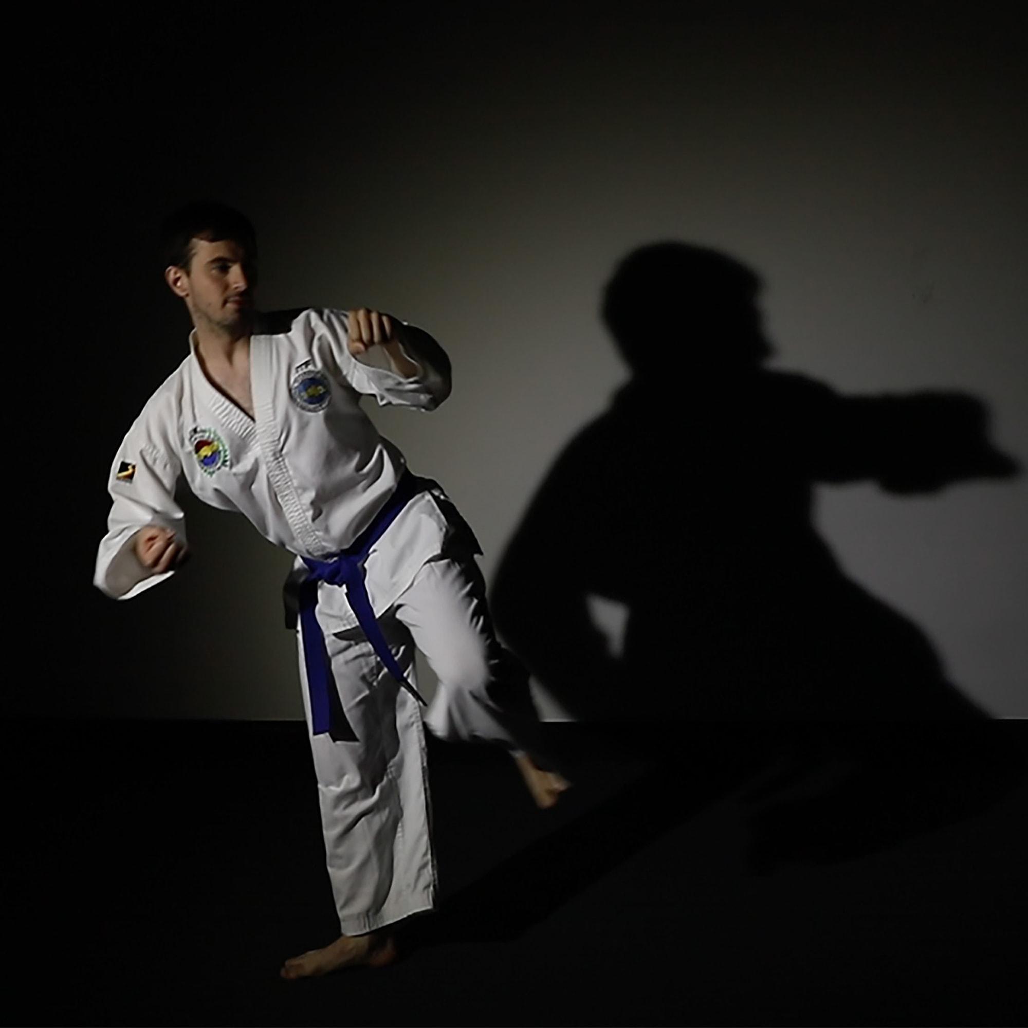 A man begins a martial arts kicking movement