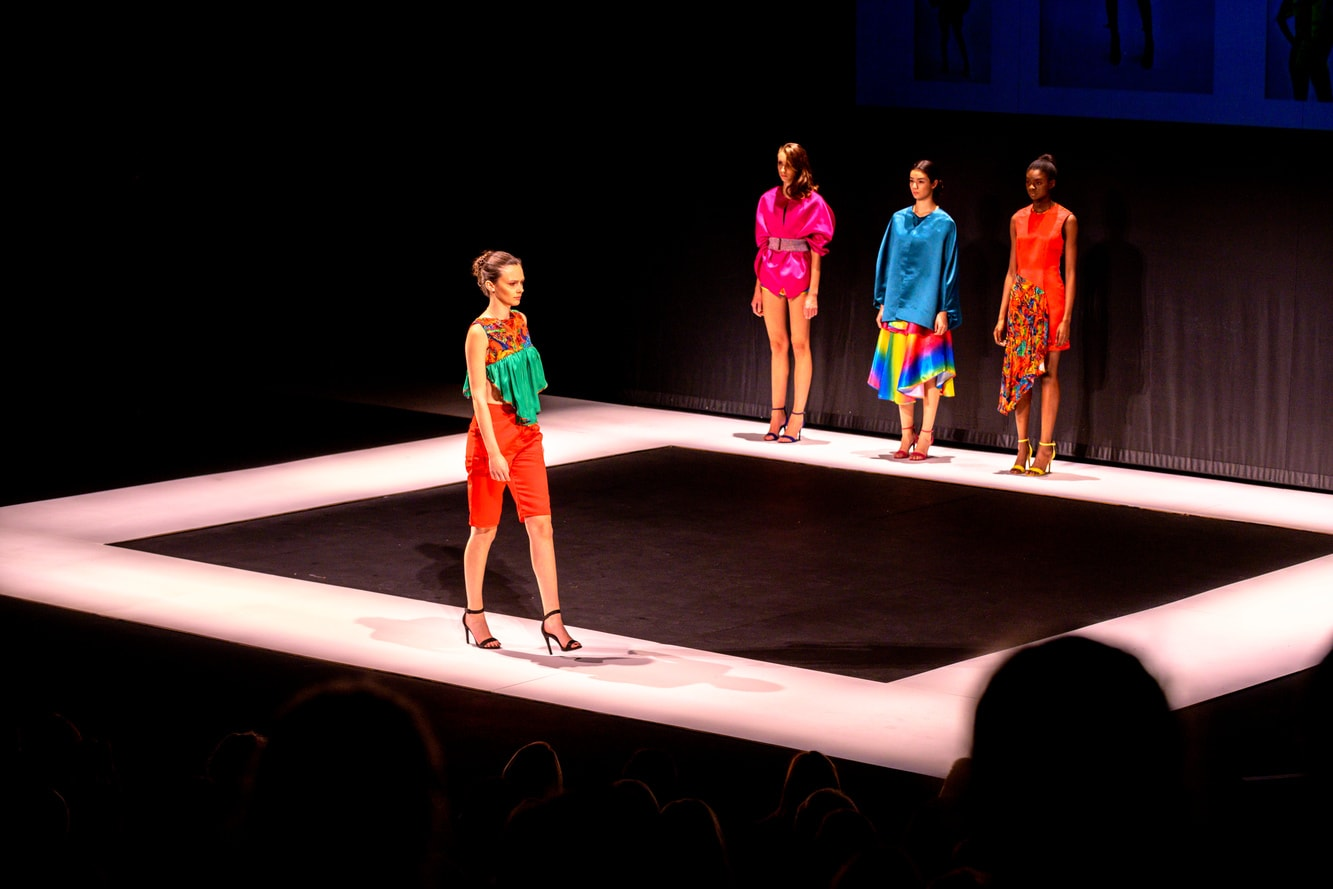 Models on a catwalk in bright and colourful designs