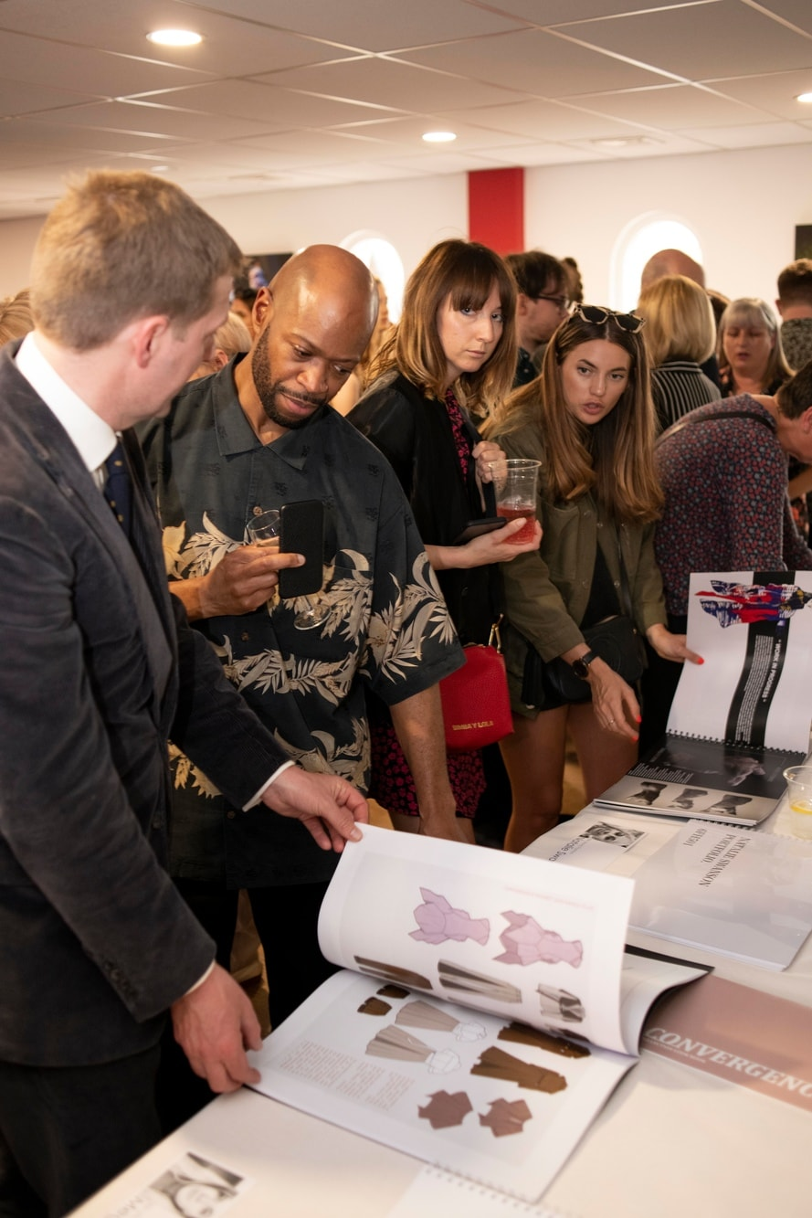 Fashion programme leaders view portfolios of collections with students