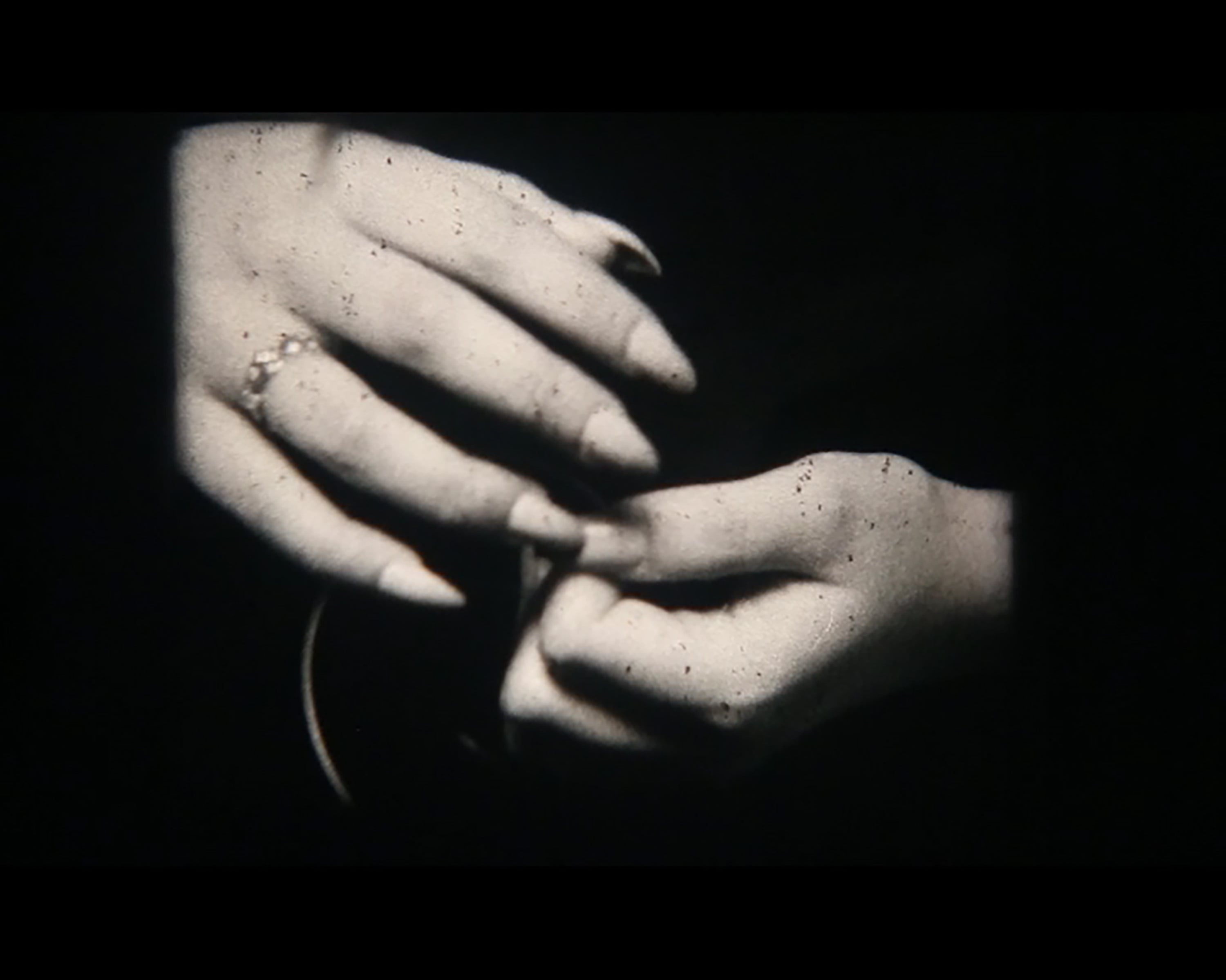 Black and white photo of a close up of someones hands