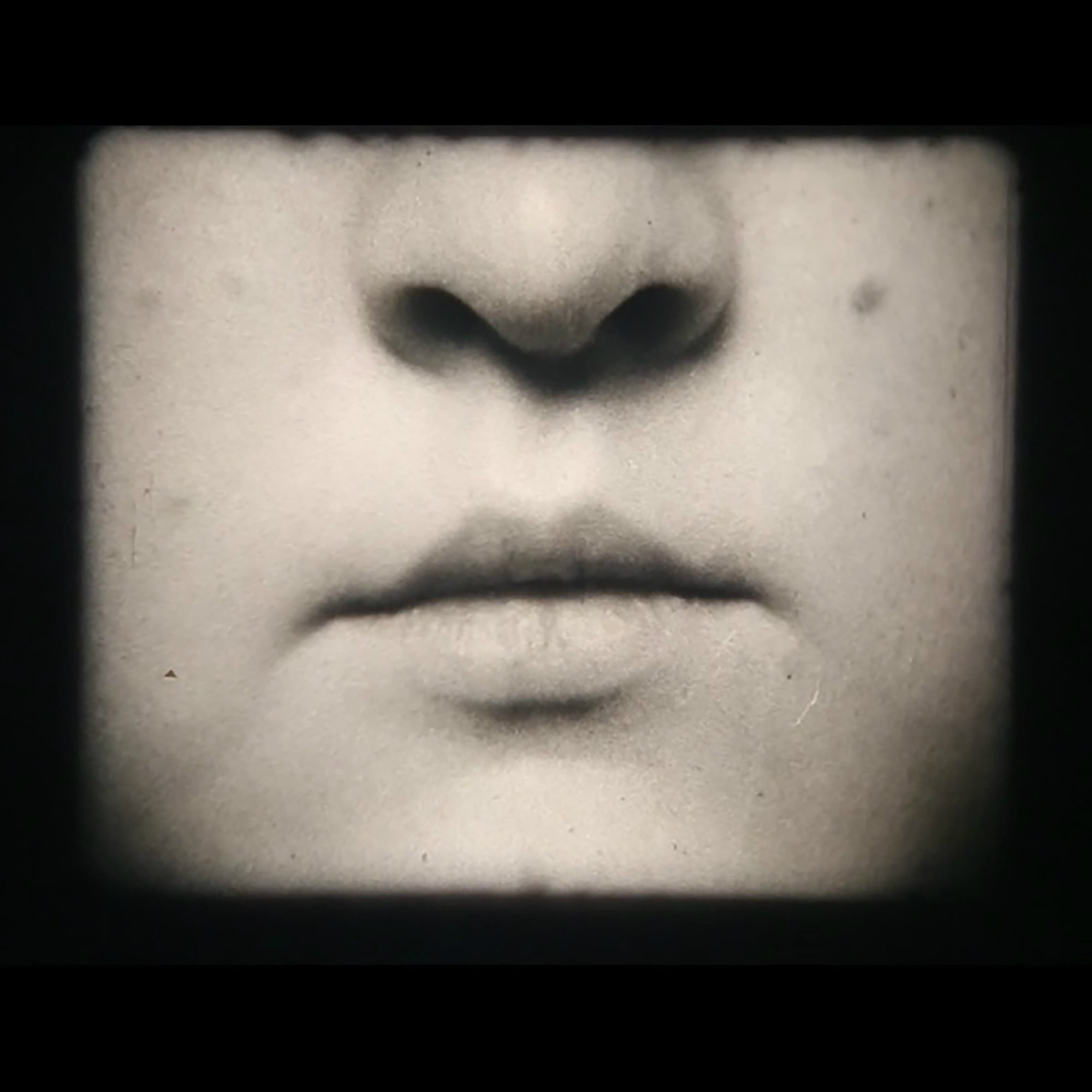 Black and white photo of a woman's nose and lips