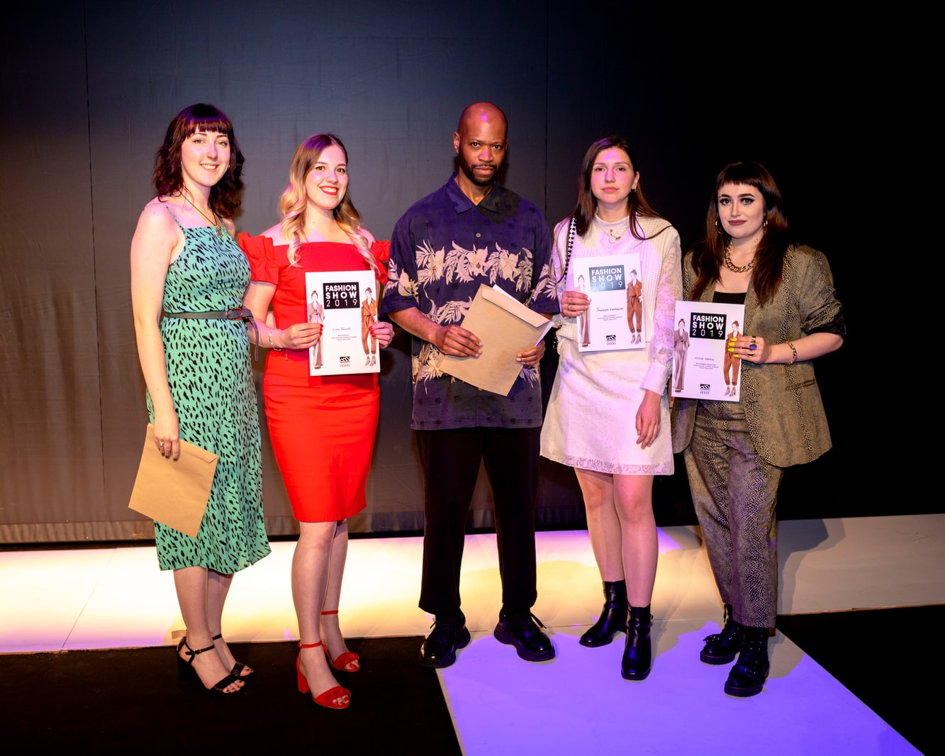 Award winning fashion students line up with their programme leader