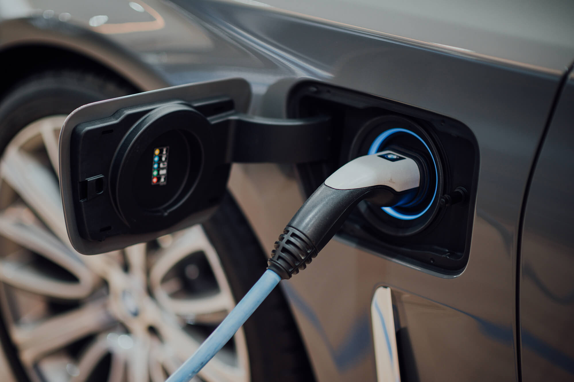 A electric car charging port on charge.