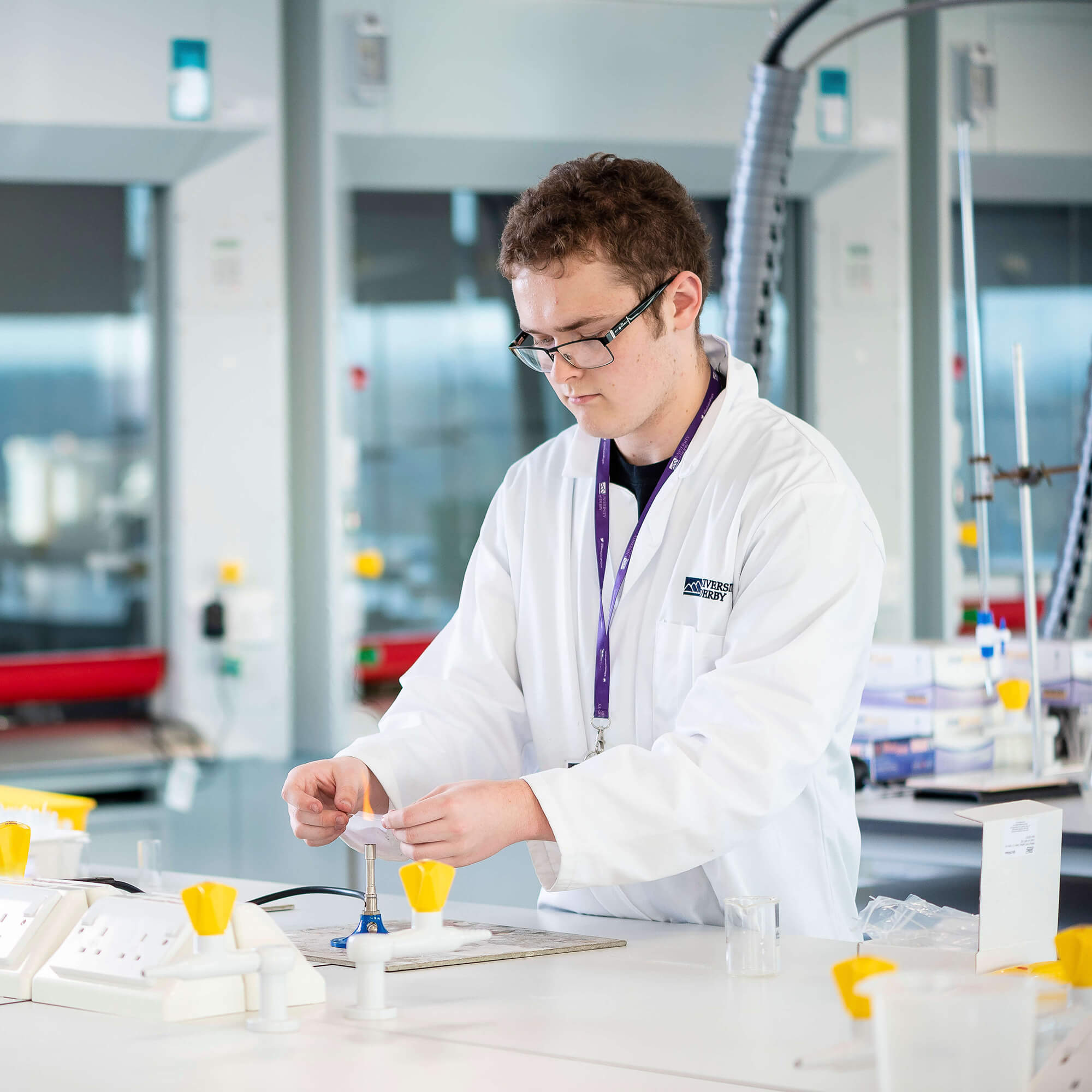 A male student working in the lab.