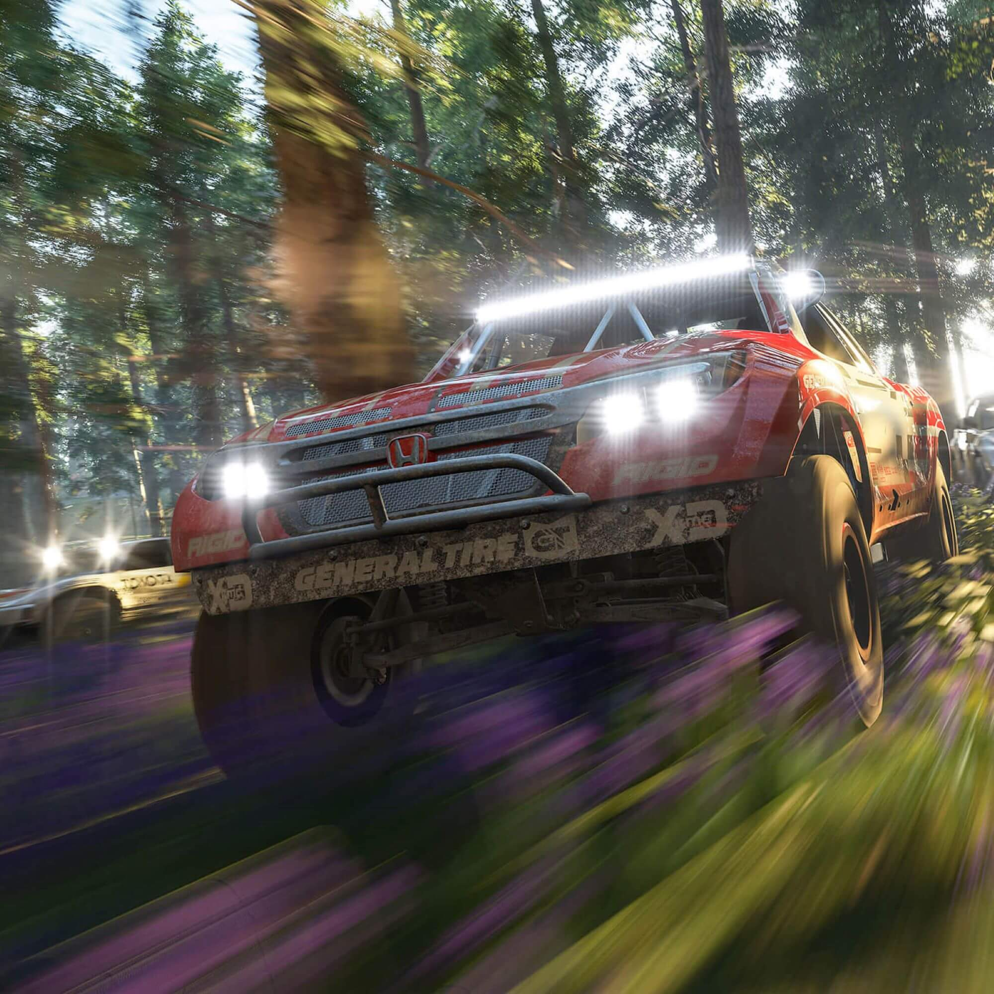 Truck driving through a forest in a computer game.
