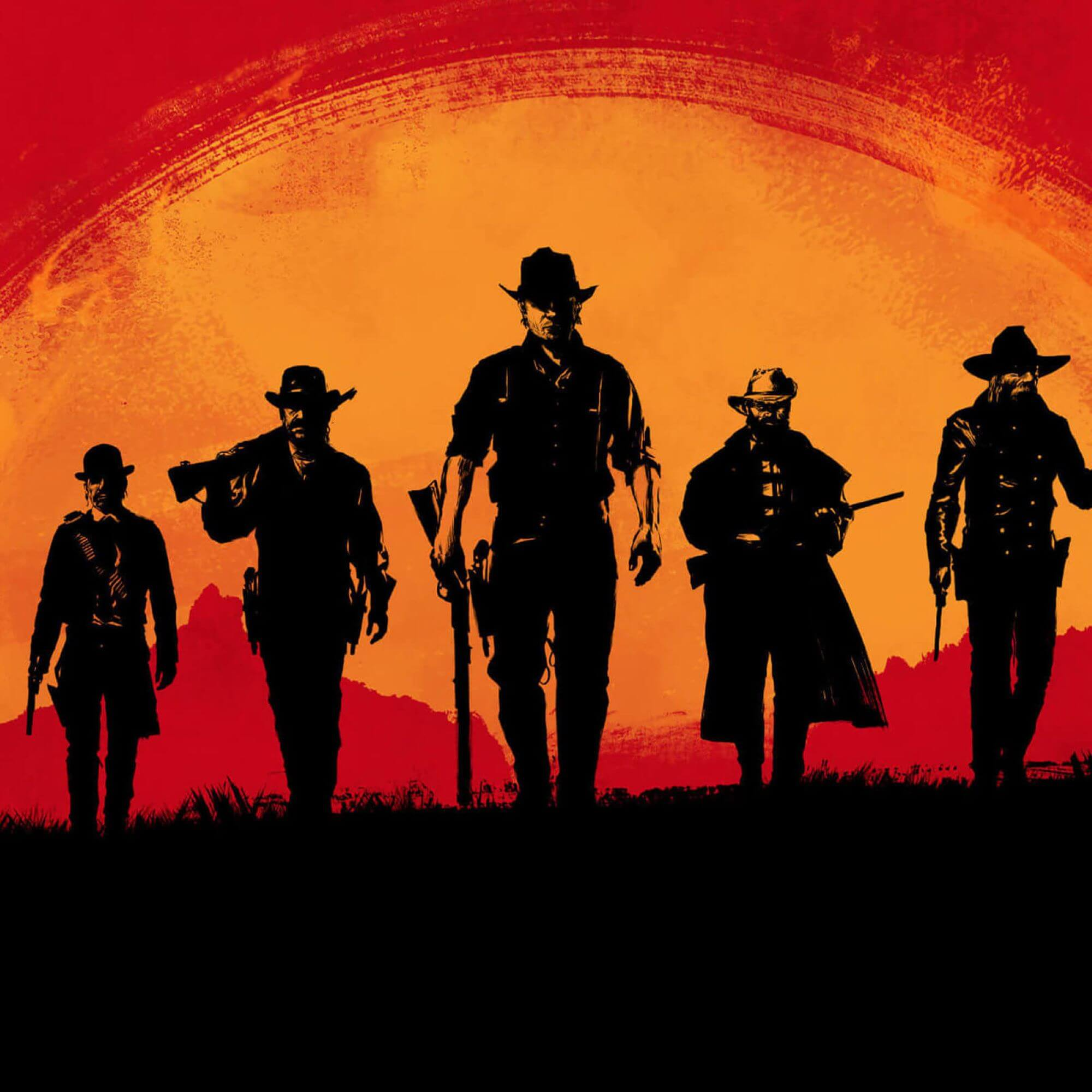 silhouettes of cowboys amongst a red and orange sky.