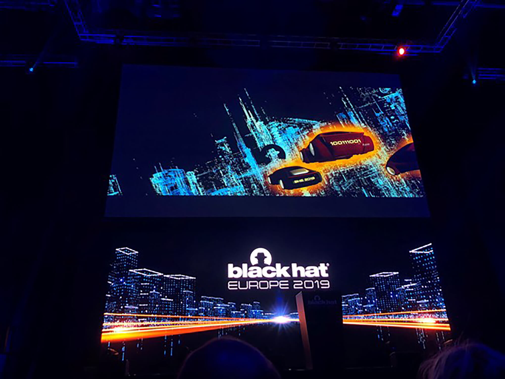 Image of a large screen at the Black Hat Cyber Security conference