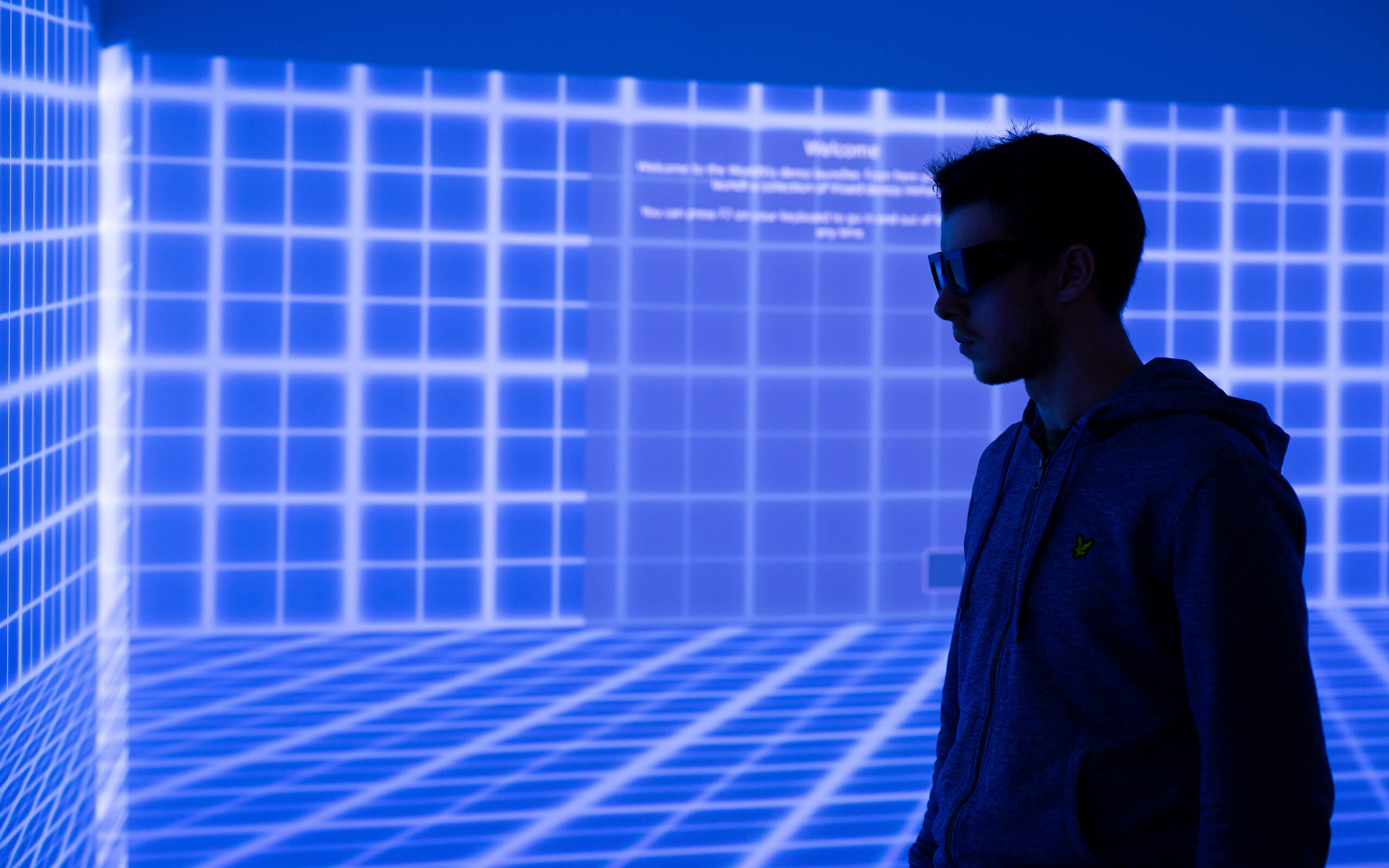 Silhouette of a student in the Data Cave at Markeaton Street.
