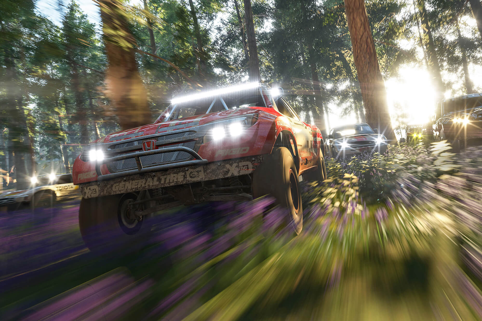 Cars racing in a forest from Forza Horizon 4