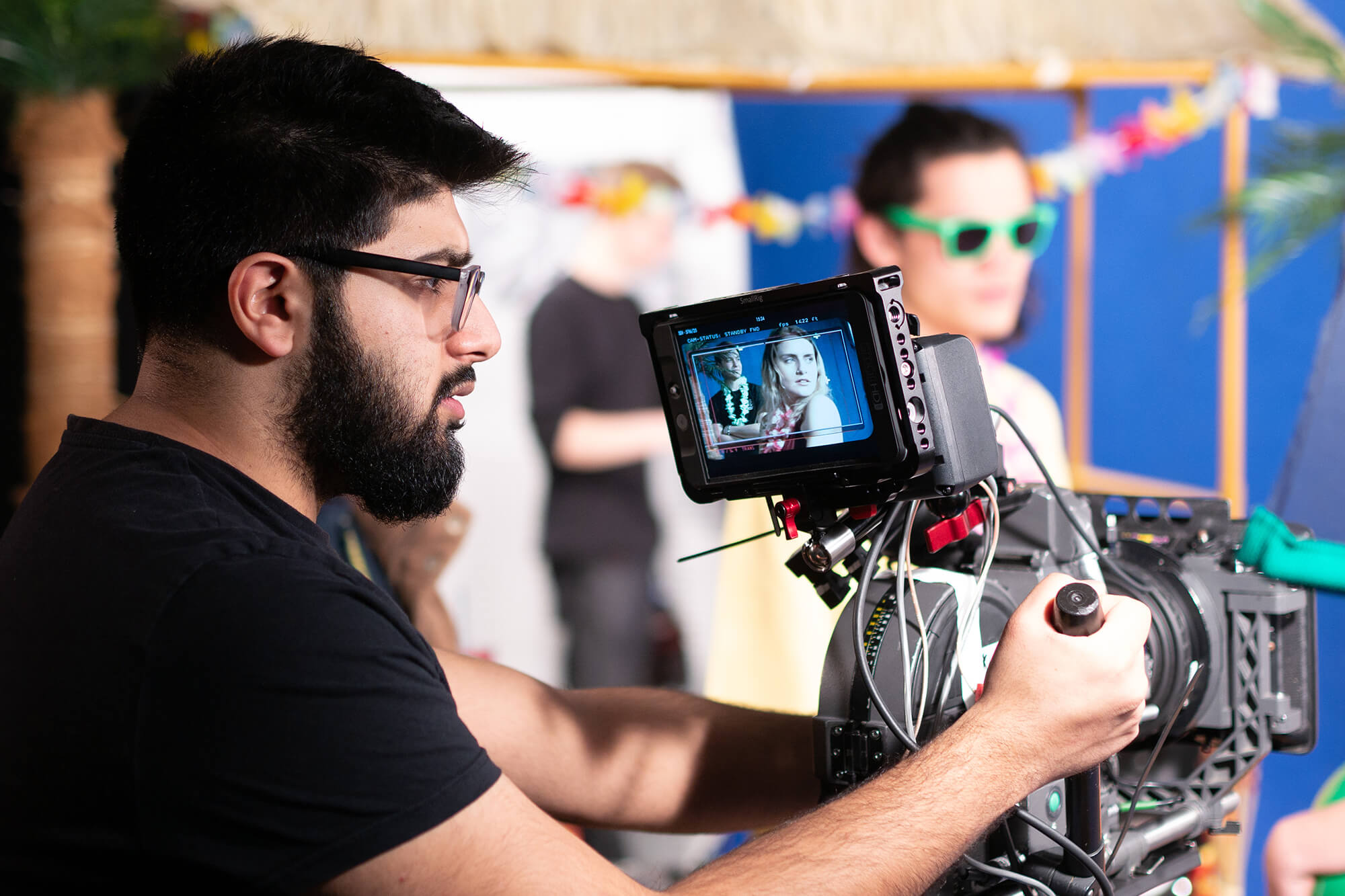 A male films and directs on a tropical commercial shoot