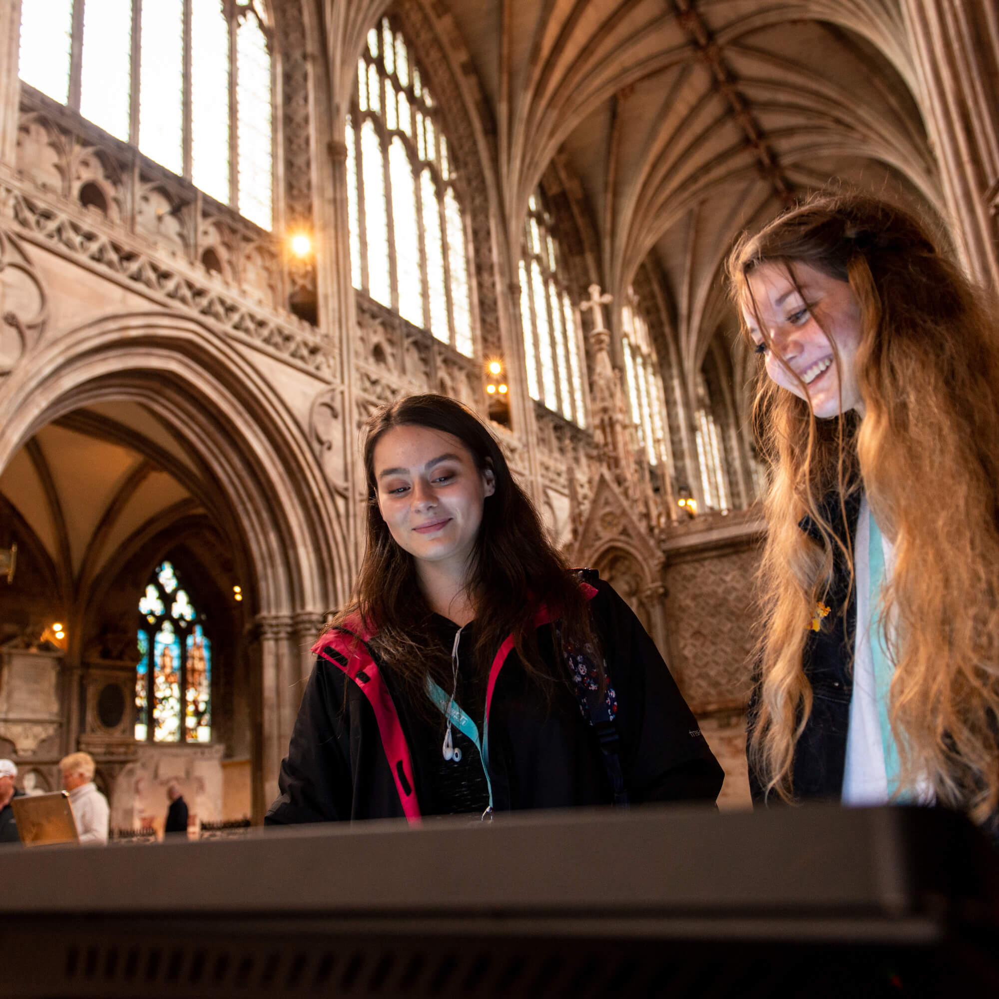 Two female students explore a place of worship