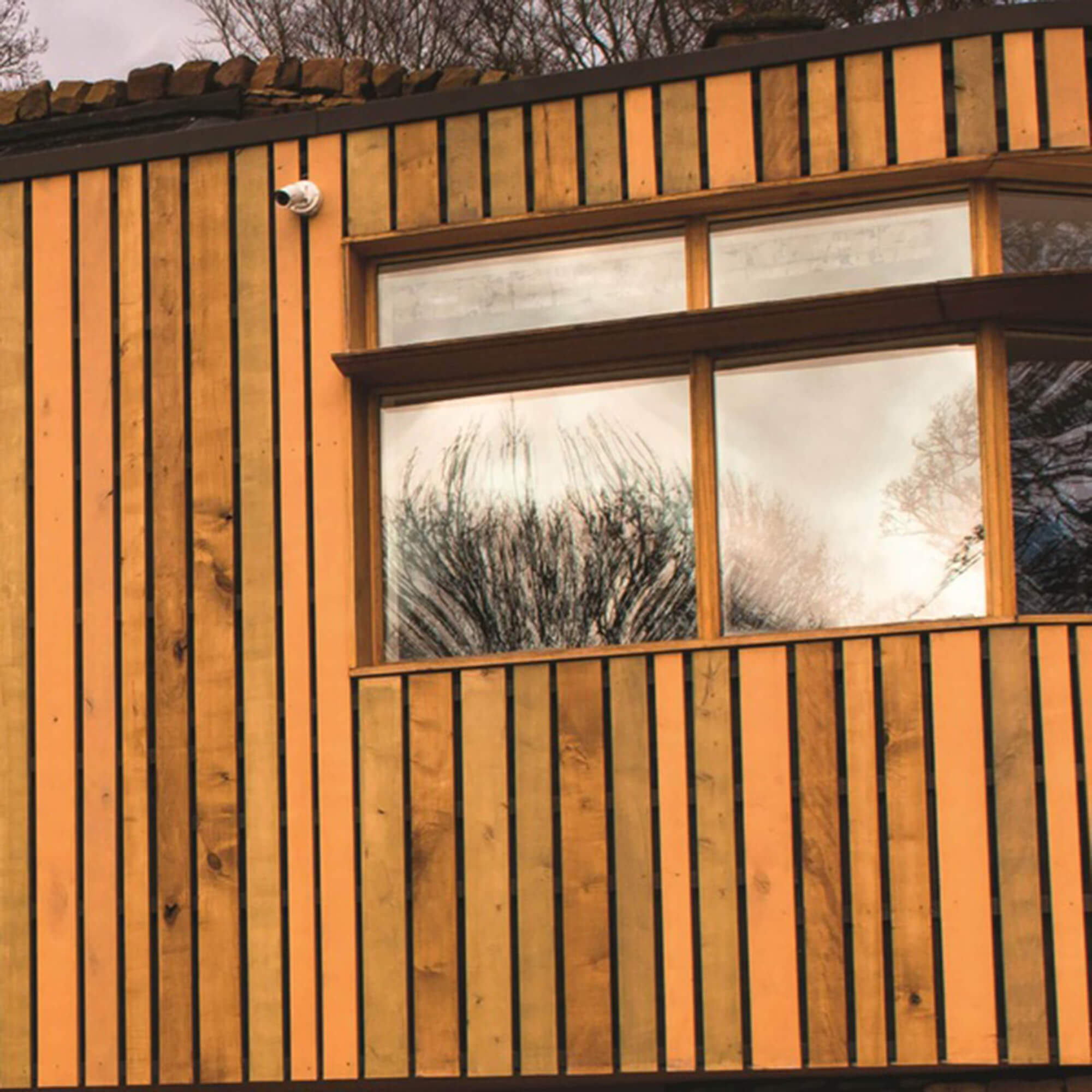 the side of sustainable house showing the wooden breathable wall