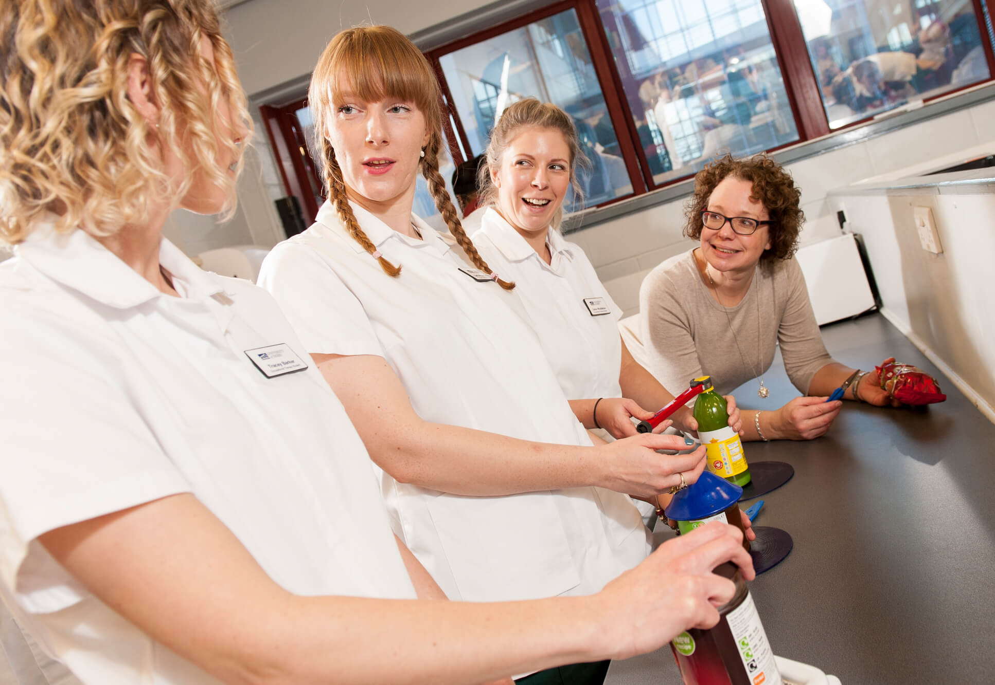 Students and lecturer in the rehabilitation kitchen during a class
