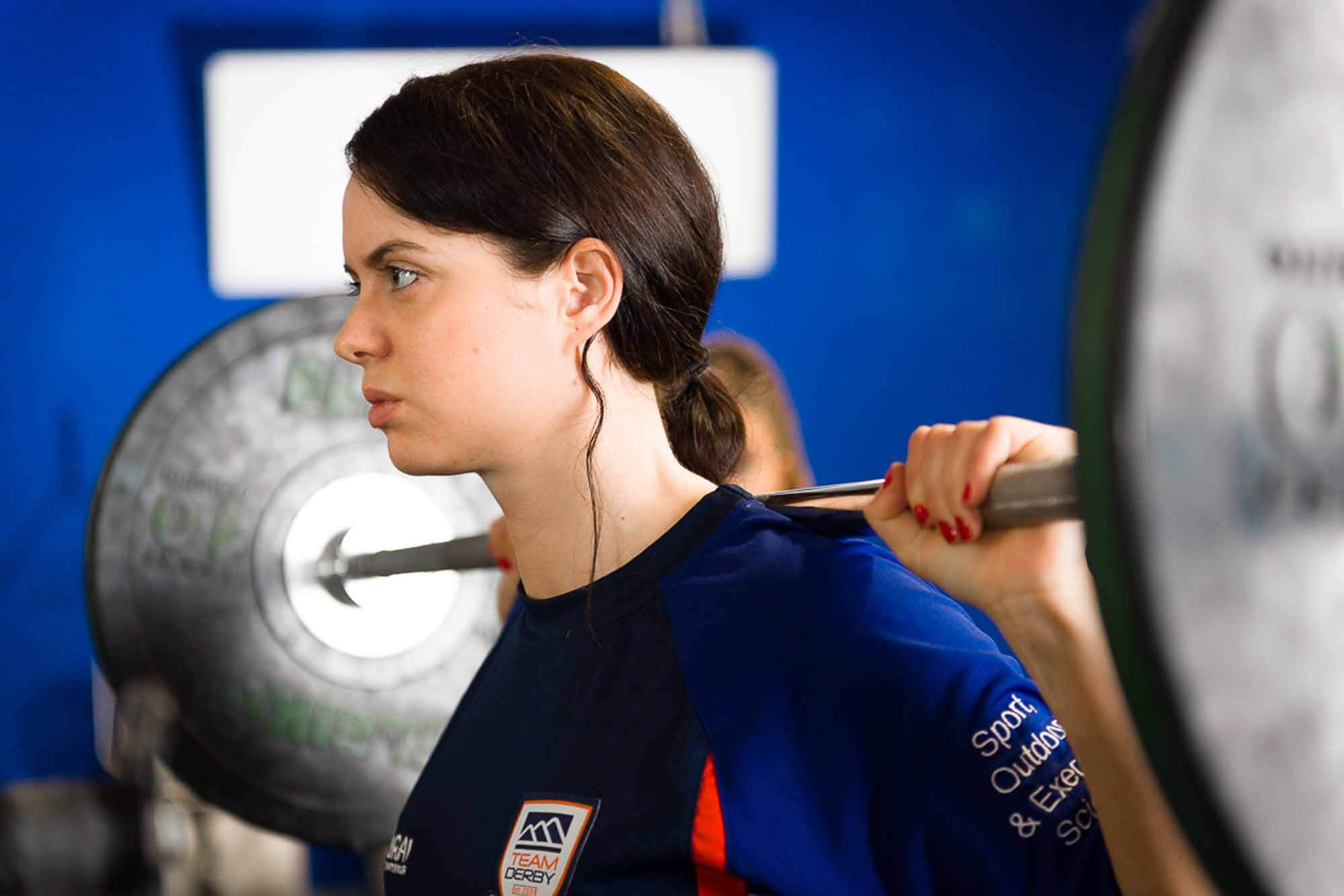 Female Sport and Exercise Science student lifting weights