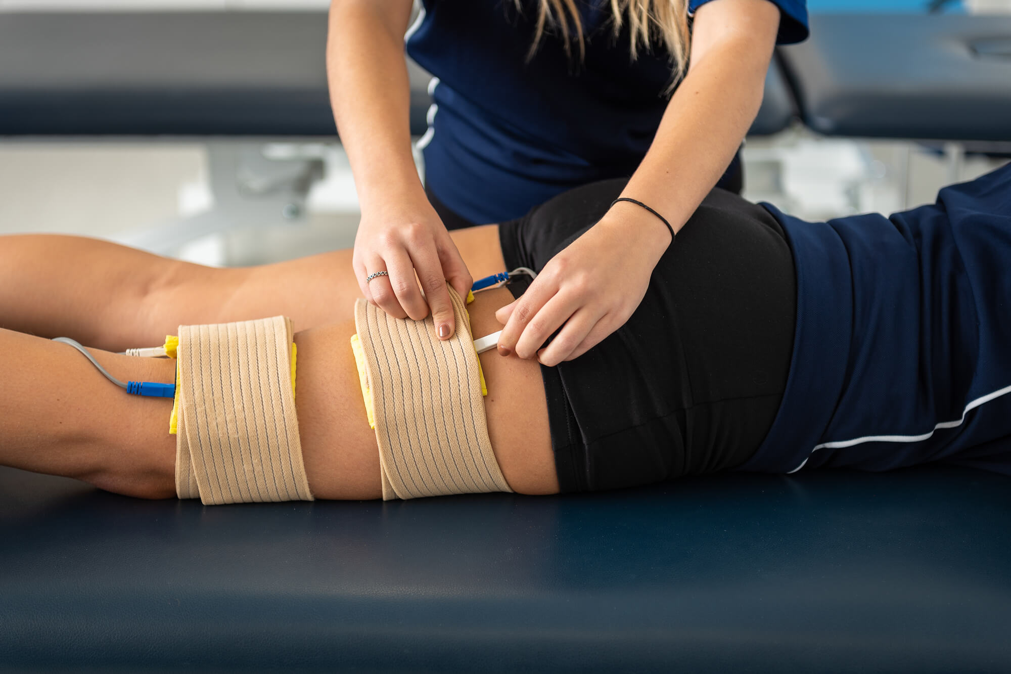 A female Sport Therapy student working in our Human Performance Unit.