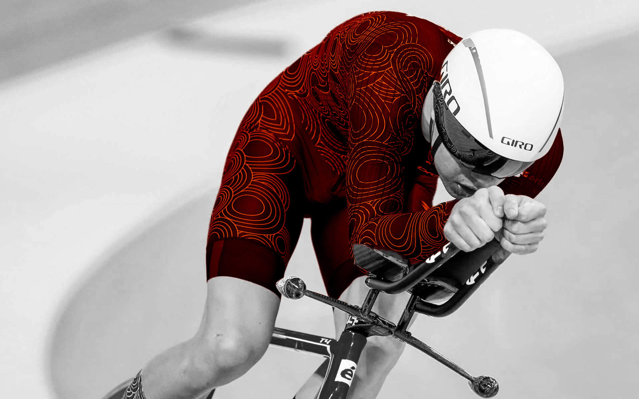 Balck and orange of a track cyclist