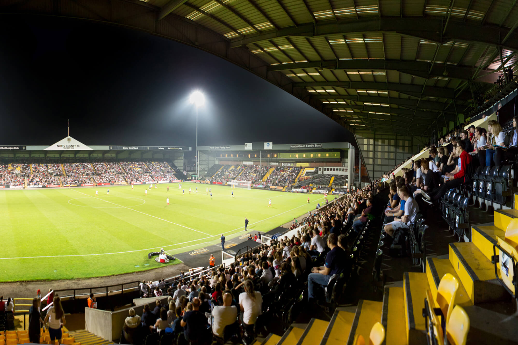 A football match with a live crowd.