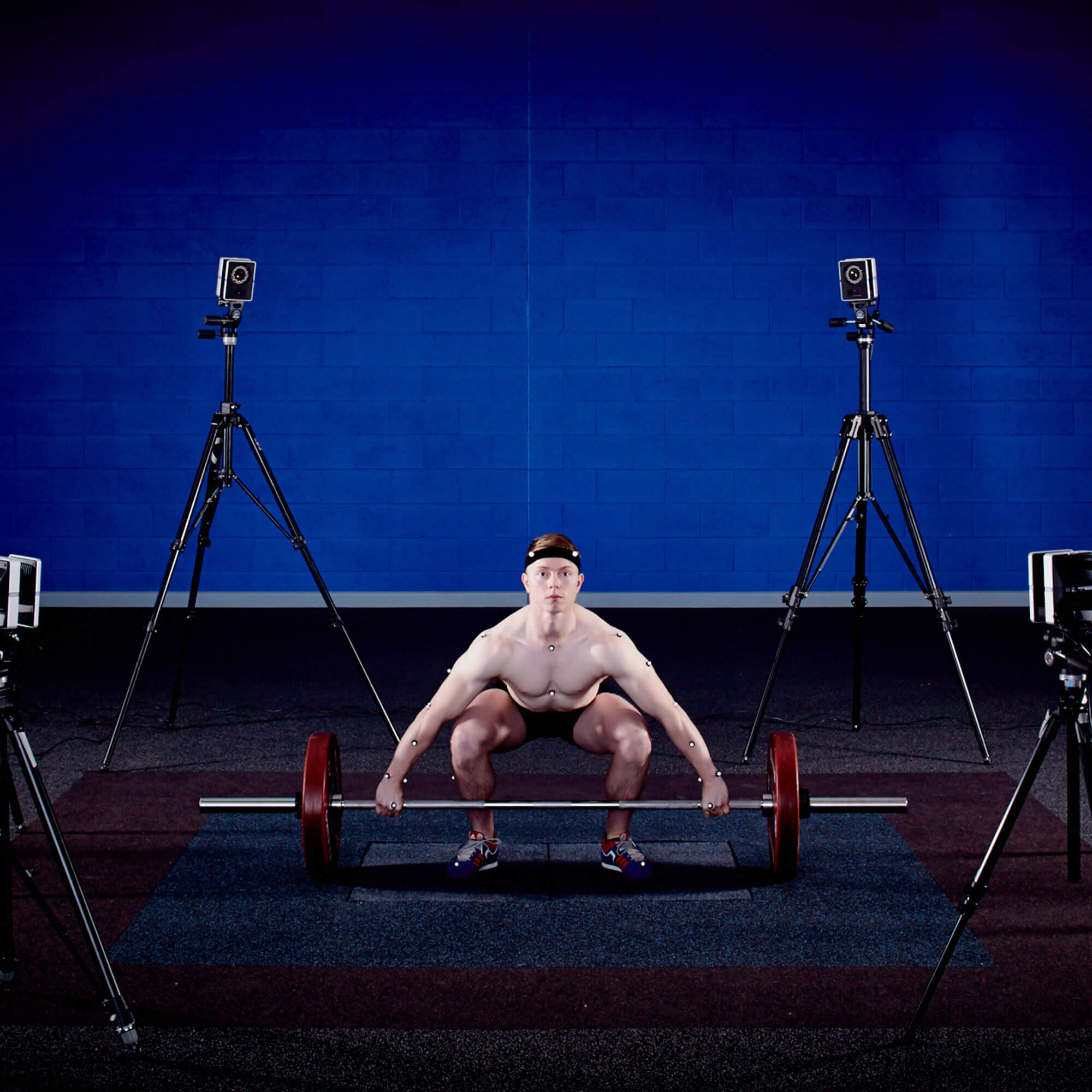A man being monitored weightlifting