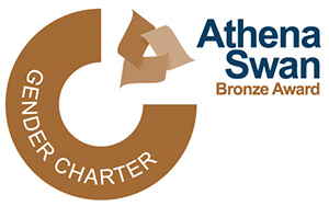 Athena Swan Bronze Award: Gender Charter. A bronze semi circle with small floating rectangles.