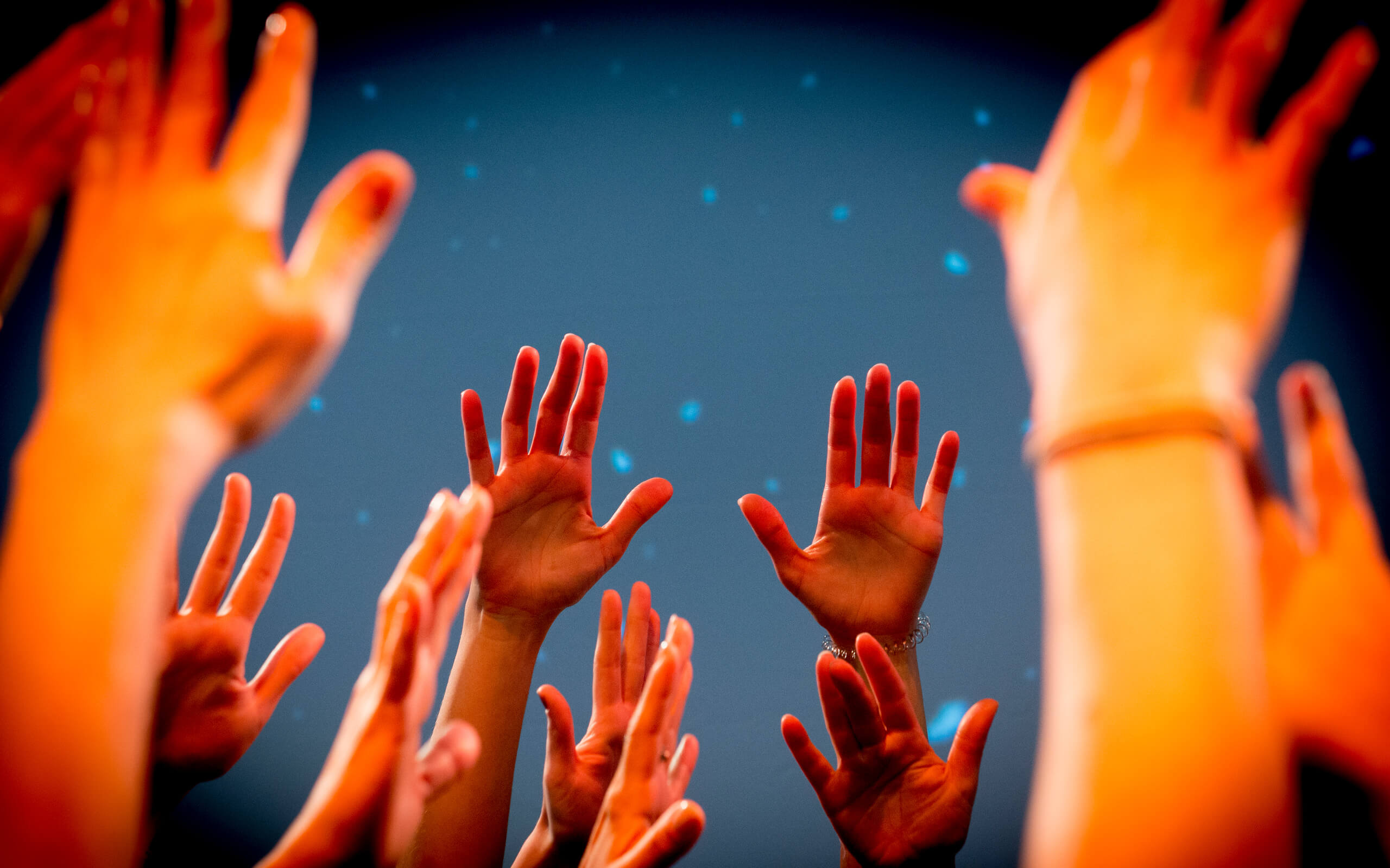 Abstract hands raised