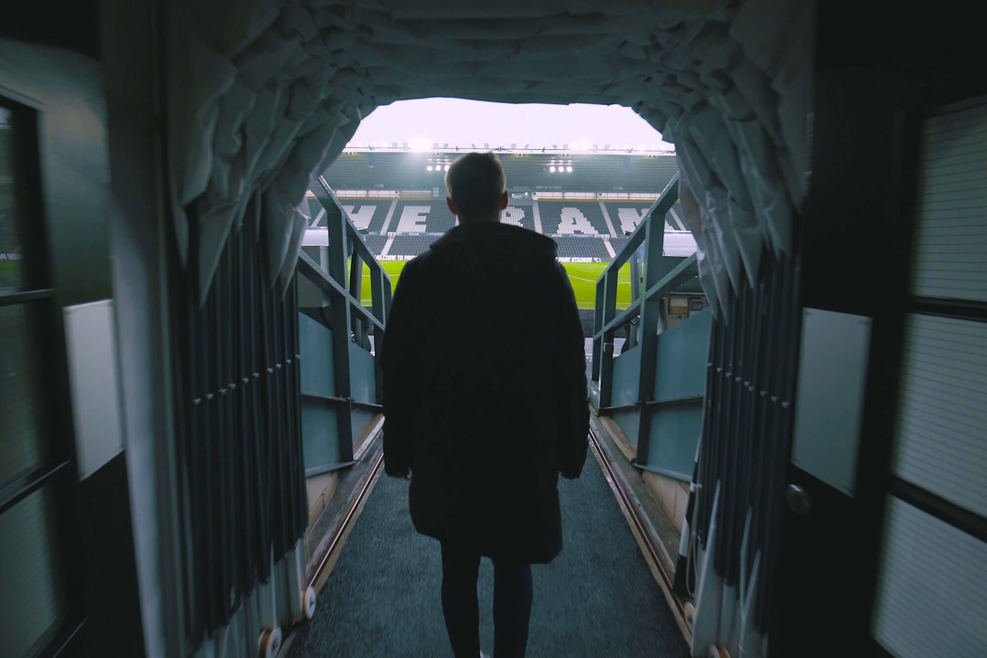Graduate Jack Webster walking in the Pride Park tunnel