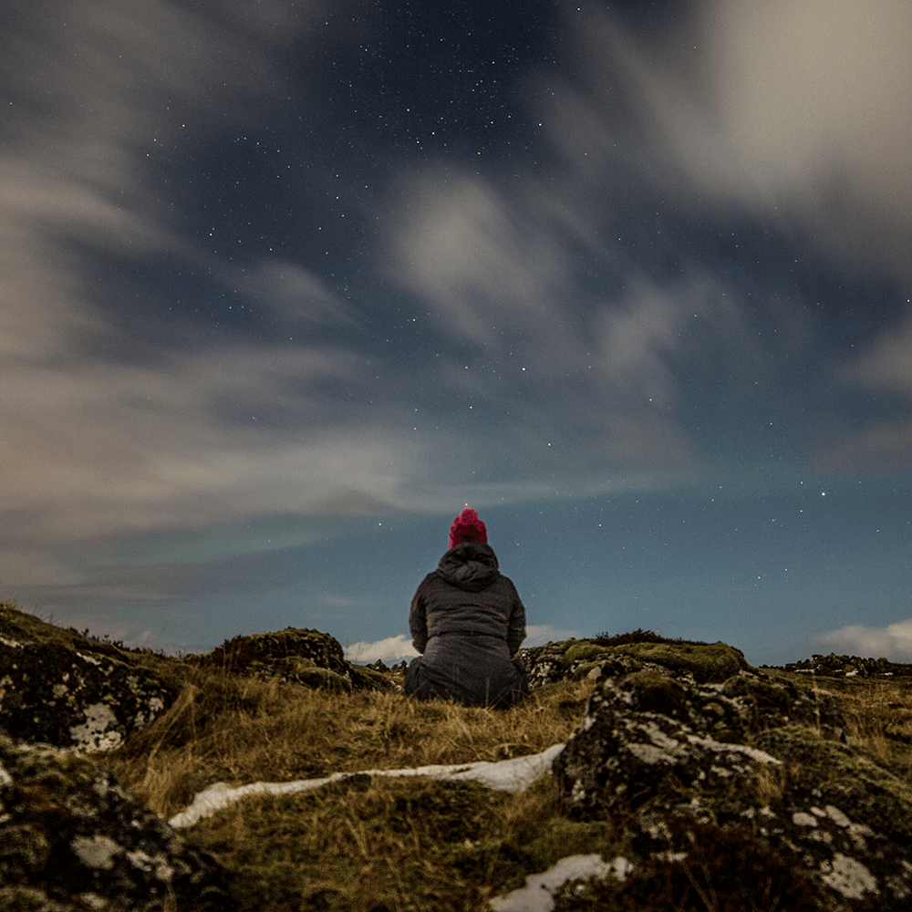 A student observes the night sky
