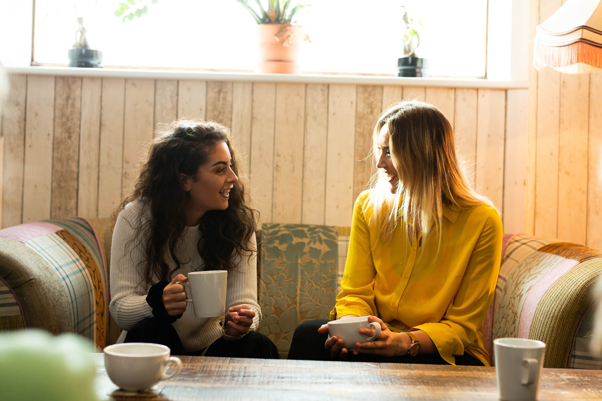 Students chatting in a coffee shop