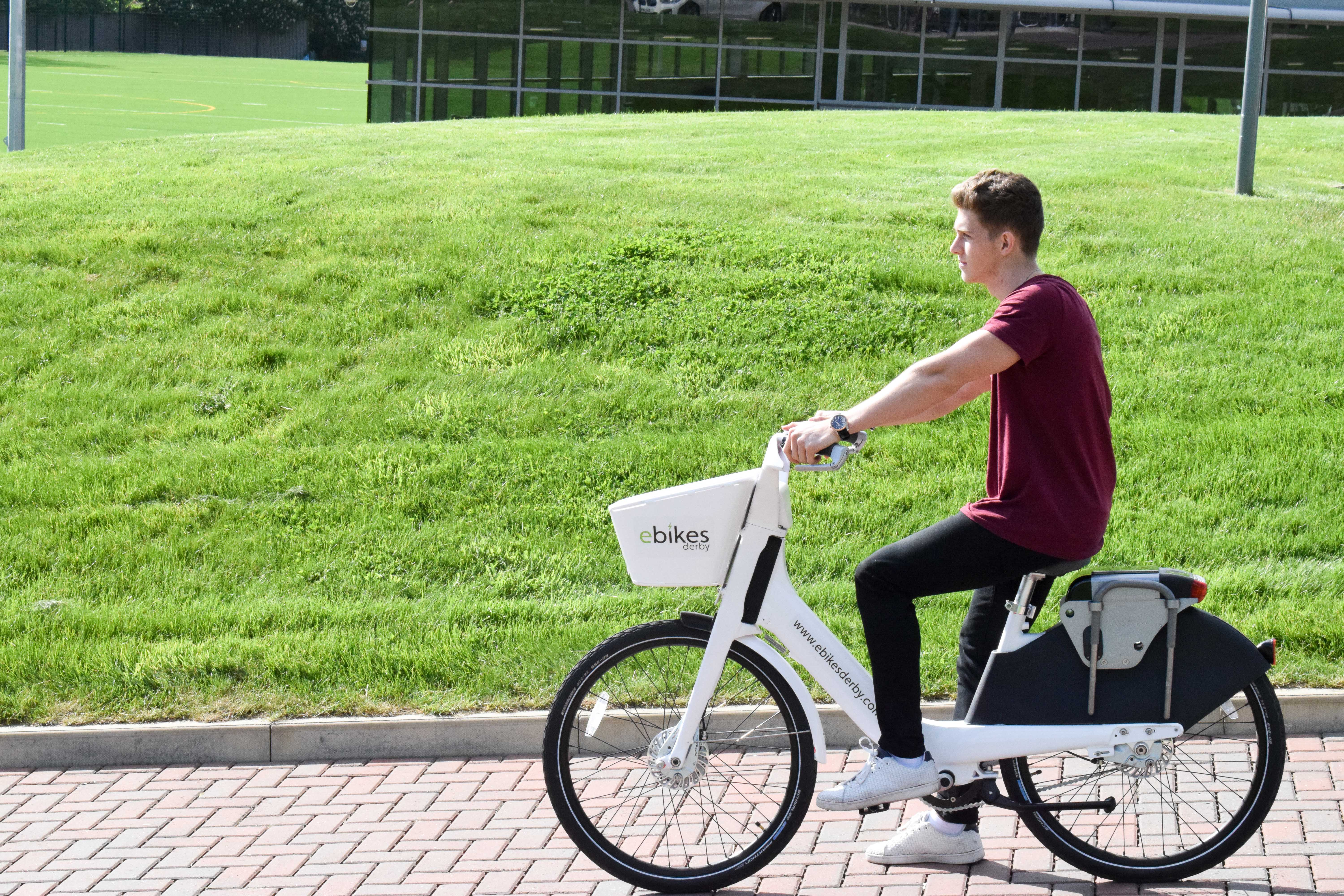 A student leaving Kedleston Road on an electric ebike