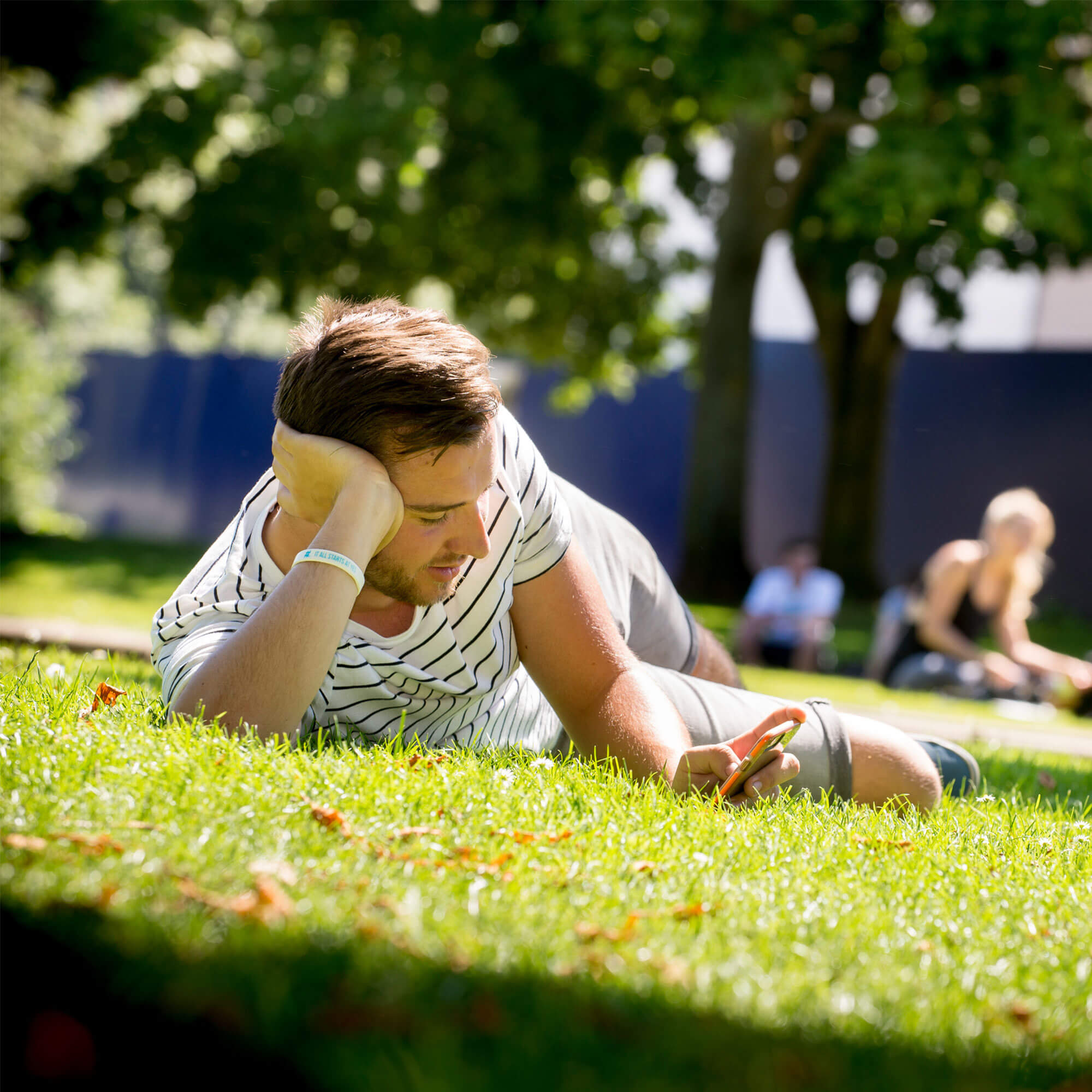 A student relaxes on grass