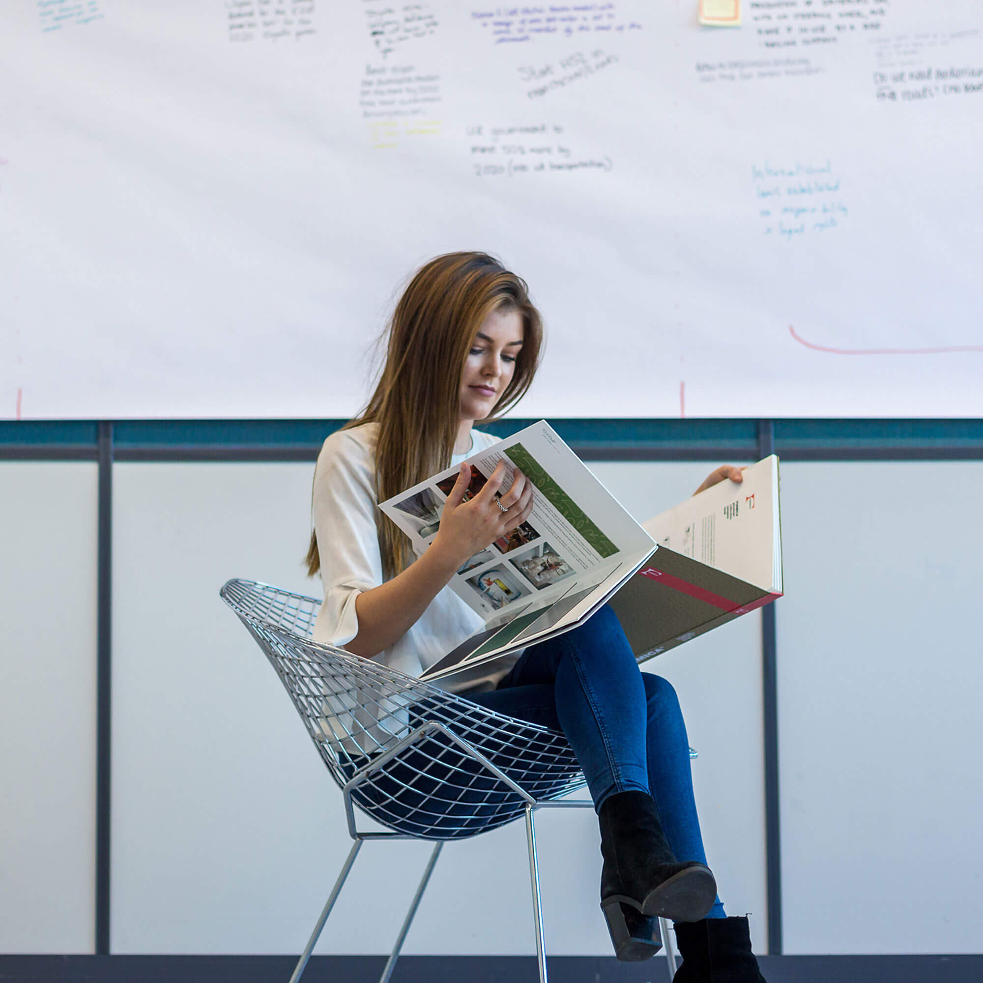 A student sits reading a publication