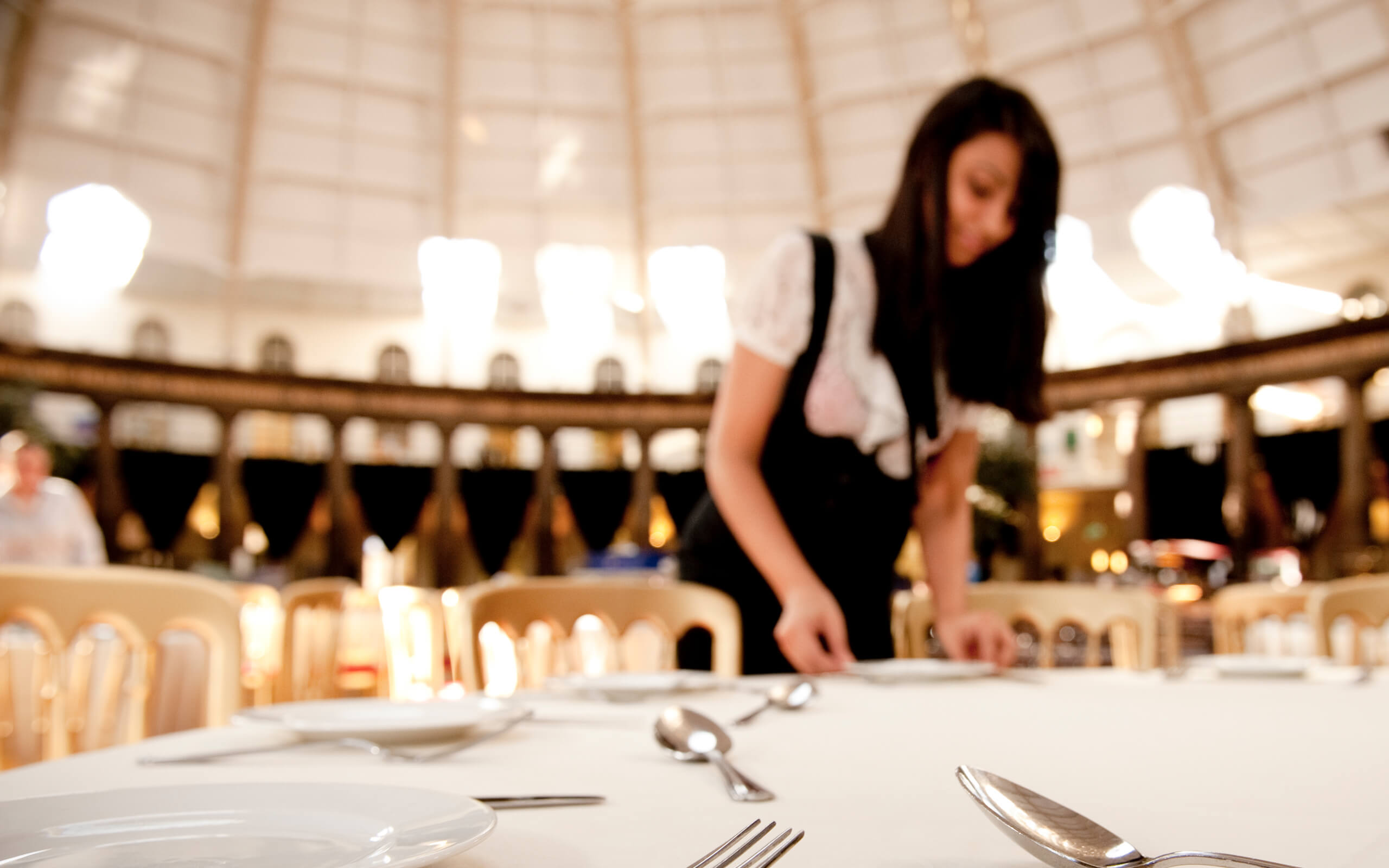 Hospitality Management student setting up at an event in the Devonshire Dome