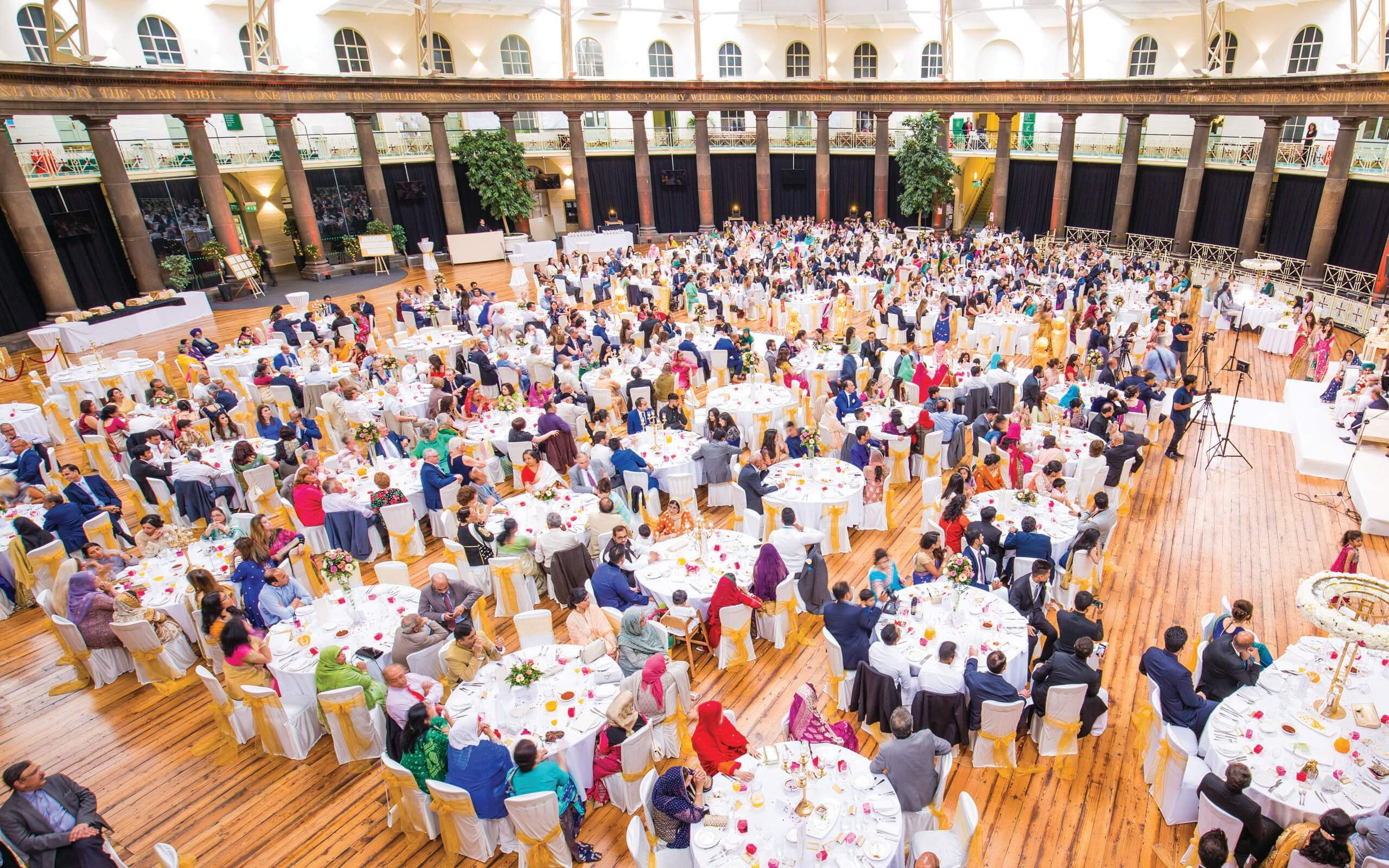 Large hospitality and catering event with busy tables of diners in buxton dome