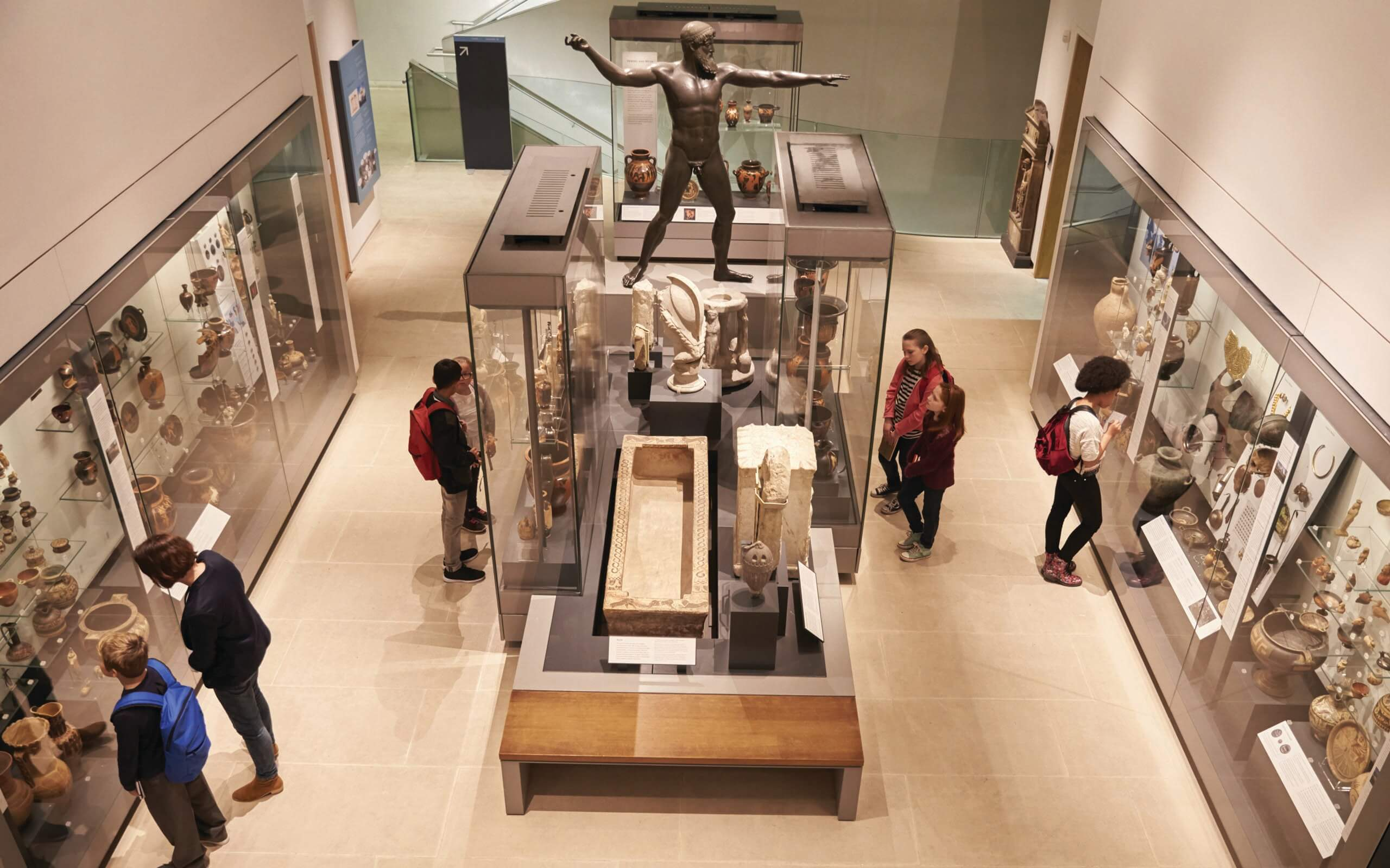 museum exhibition of sculpture and artifacts from ancient civilizations