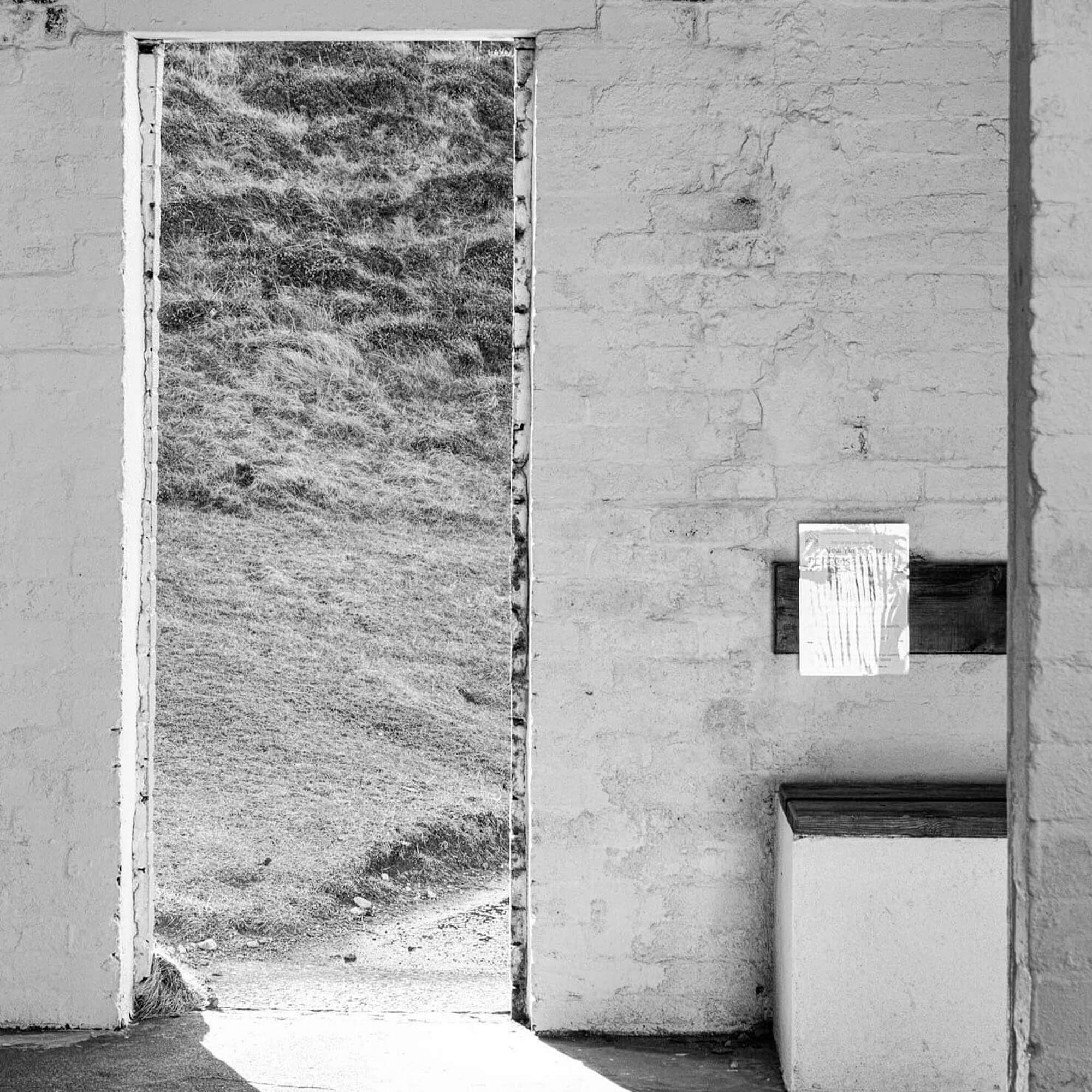 Black and white photography or a decrepit doorway