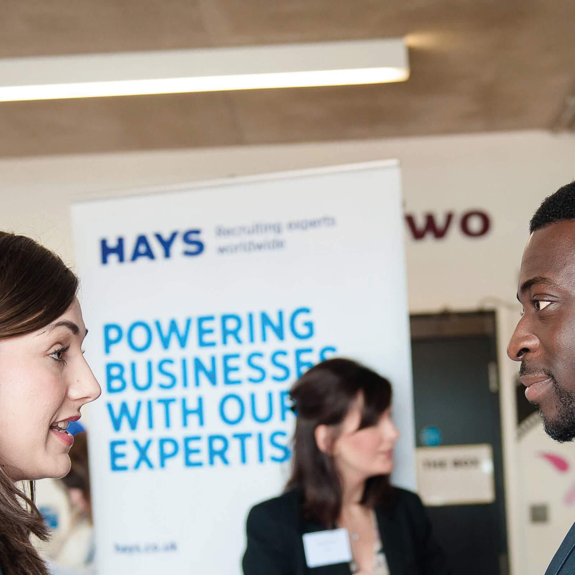 candidates at a careers fair with employers and employees