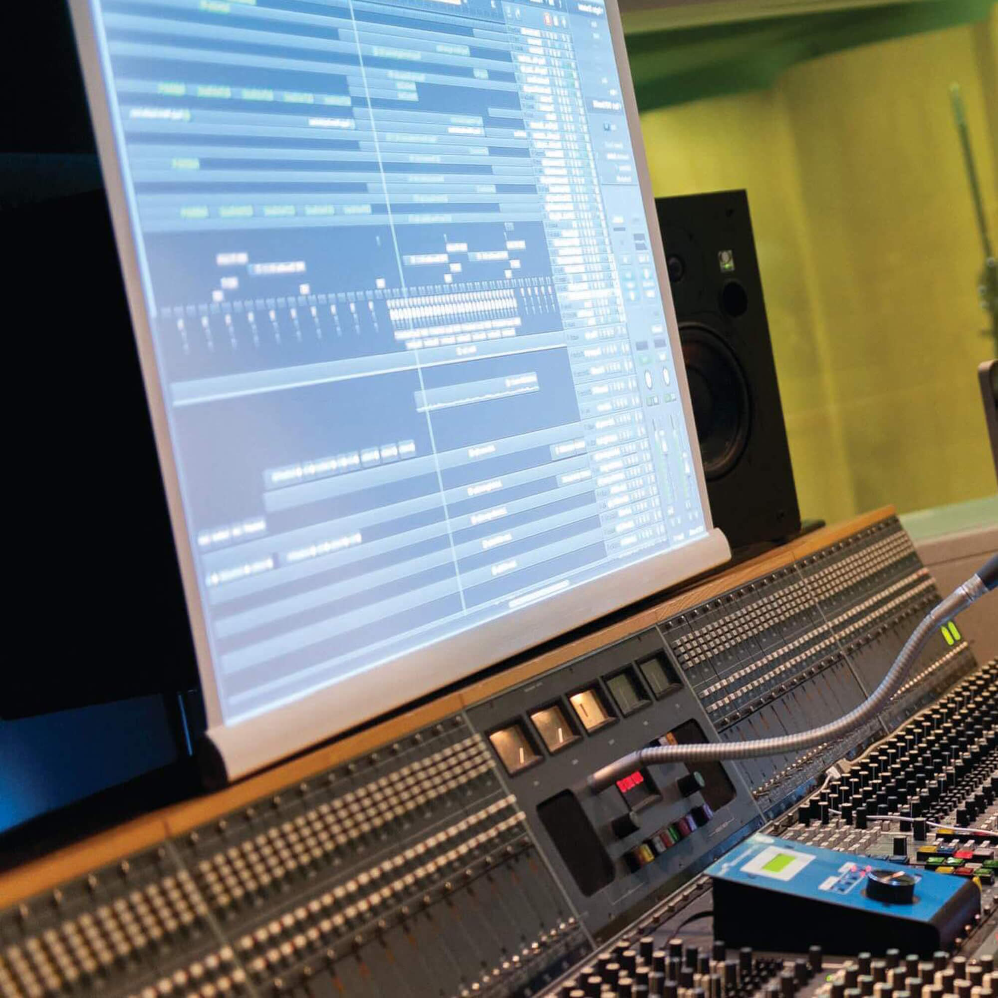sound engineering on mixing desk mastering audio tracks