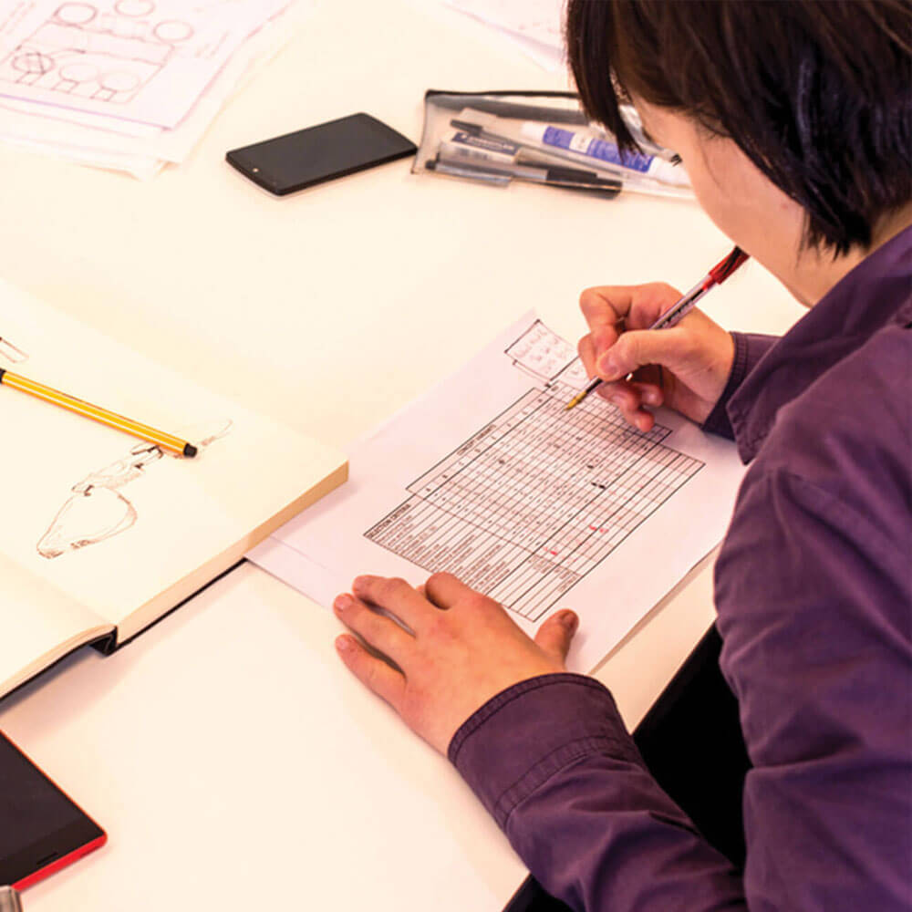 Student completing work for Product design course