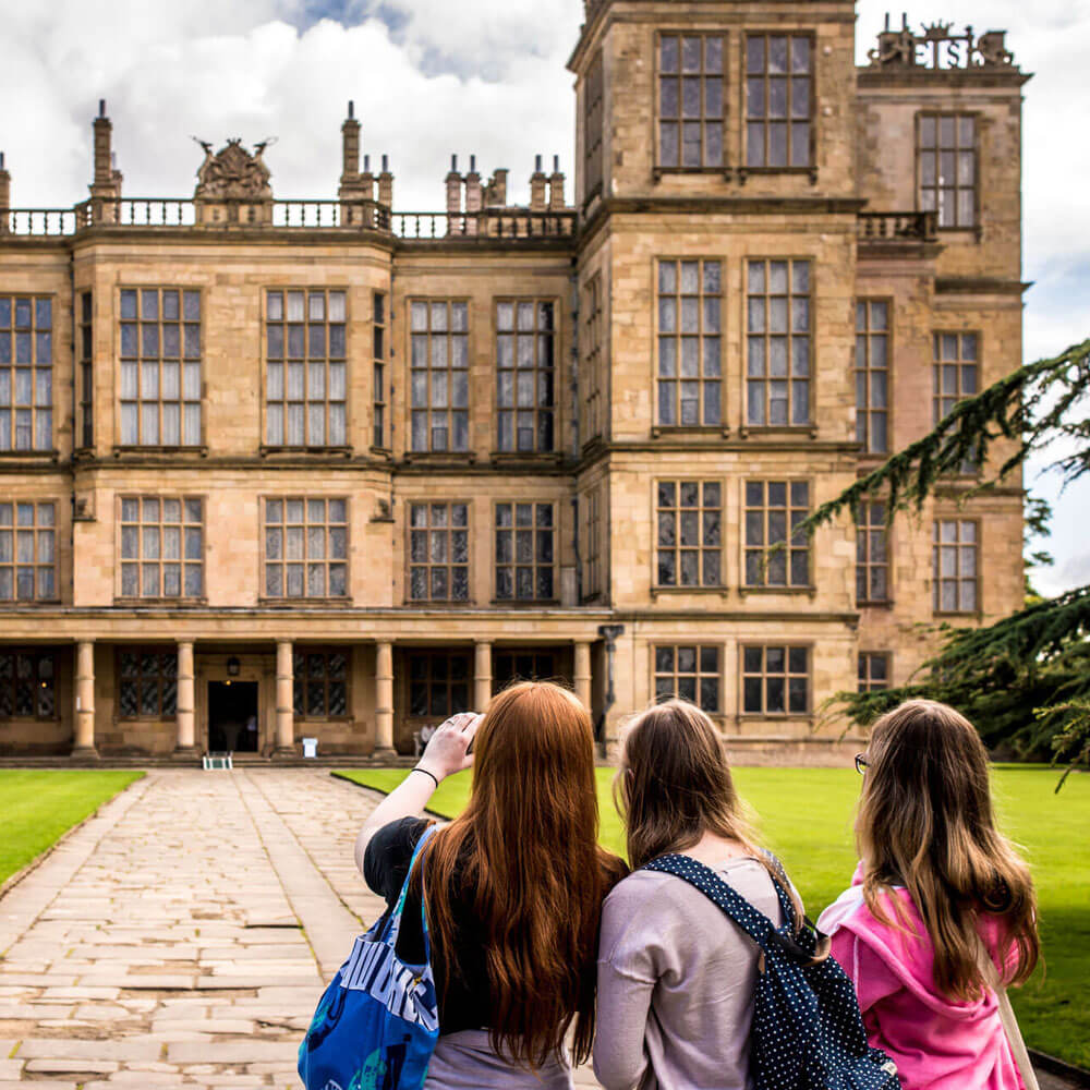 History students taking a photo of Hardwick hall on a field trip on History course