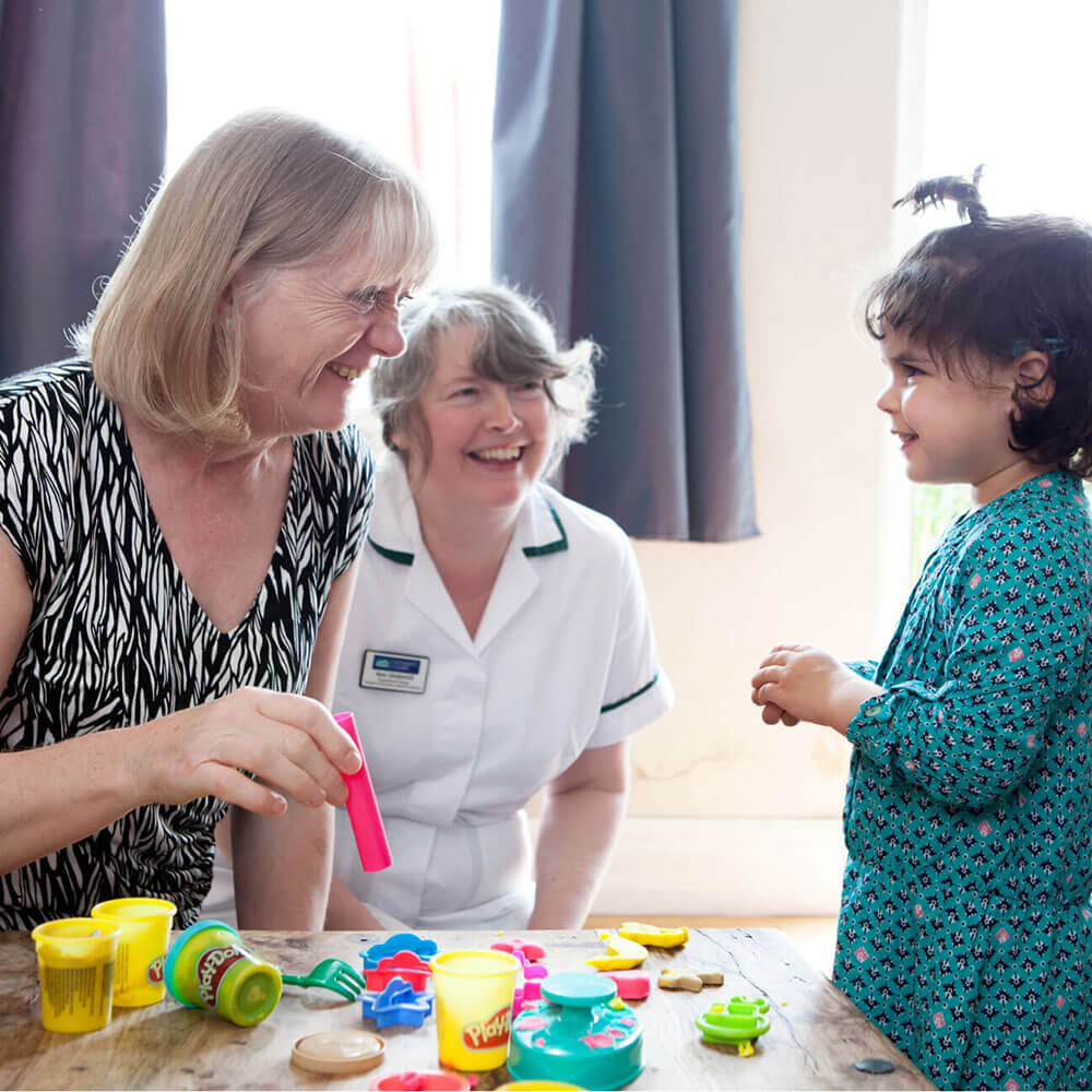 Occupational Therapy students working with a child during Occupational Therapy courses