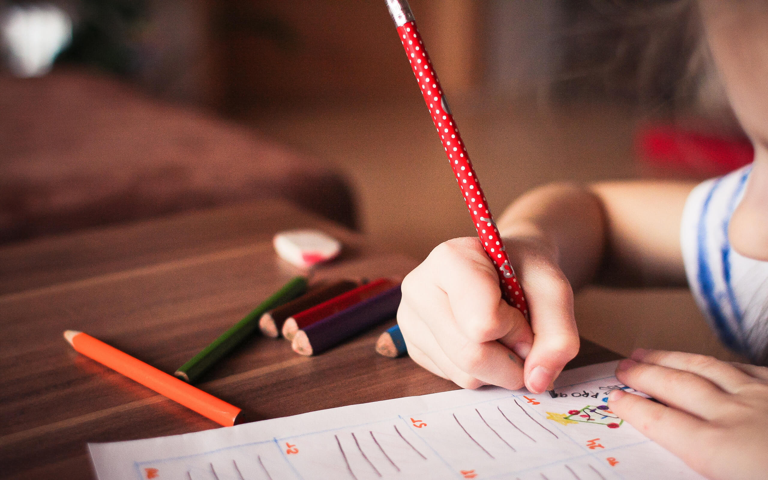 a small child using a pencil