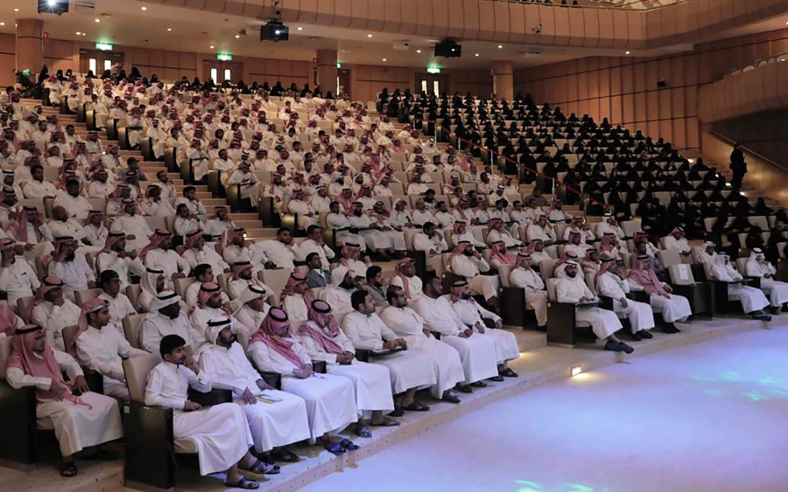 People sat in lecture theatre for Health and Safety conference in Saudi Arabia